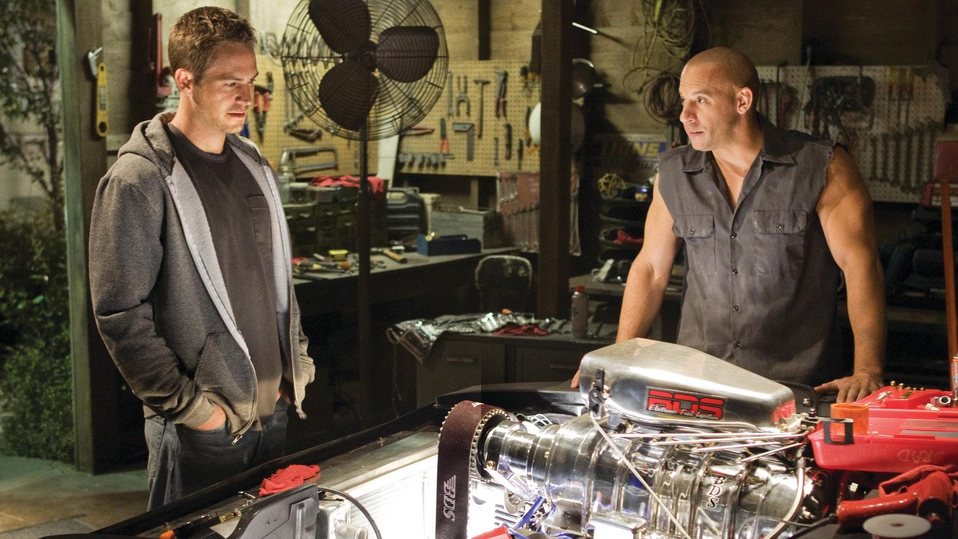 "Paul Walker and Vin Diesel in a scene ""Fast & Furious 7."""