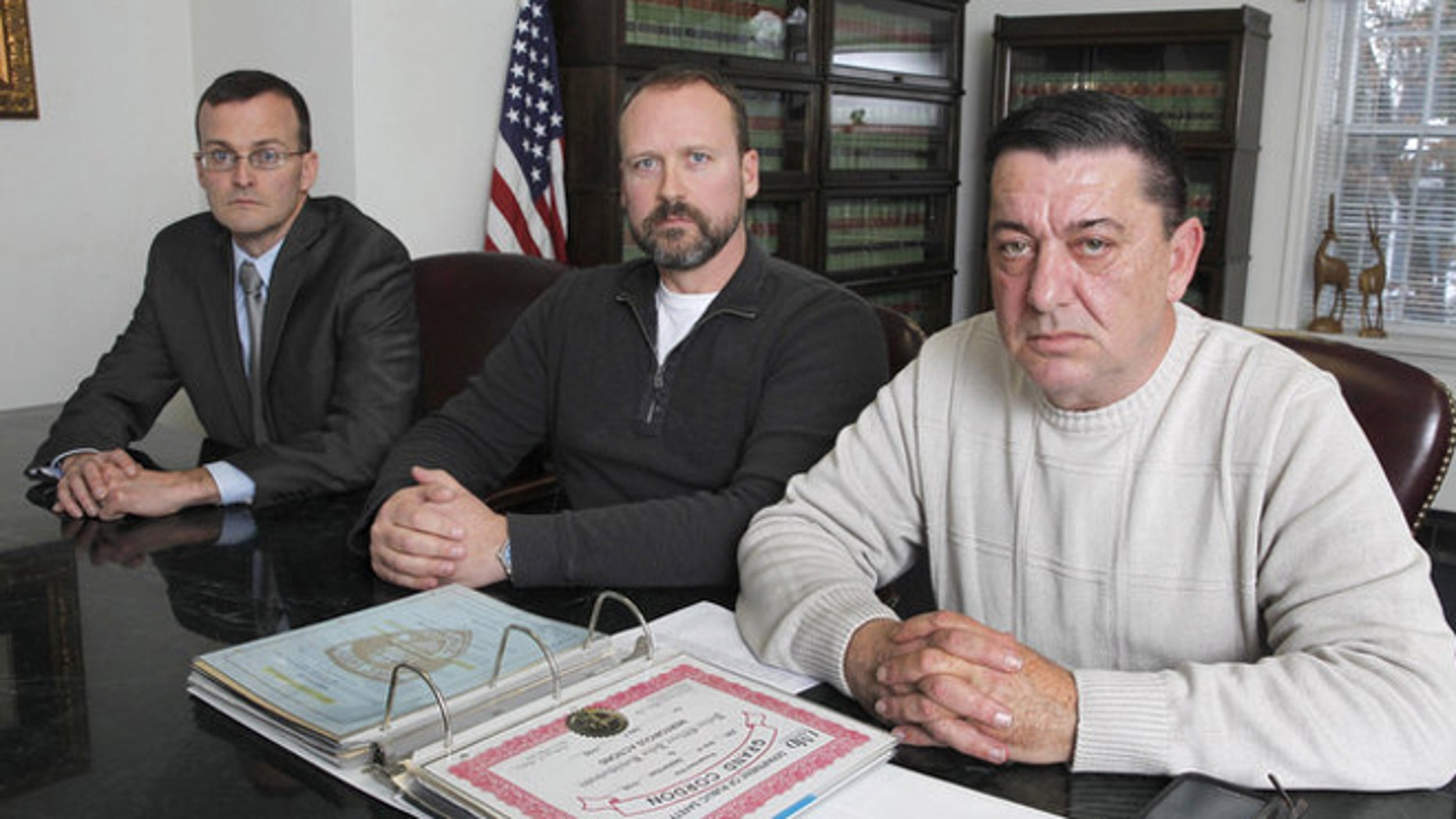 Attorney Thomas Roughneen,with clients, retired public university police officers Robert Dunsmuir and John Kotchkowski. (Jerry McCrea | For NJ Advance Media)