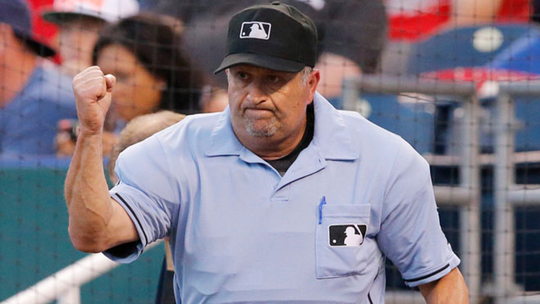 June 5, 2014: This photo shows umpire Dale Scott calling out St. Louis Cardinals' Yadier Molina after a play review in the fifth inning of a baseball game against the Kansas City Royals at Kauffman Stadium in Kansas City, Mo. (AP)