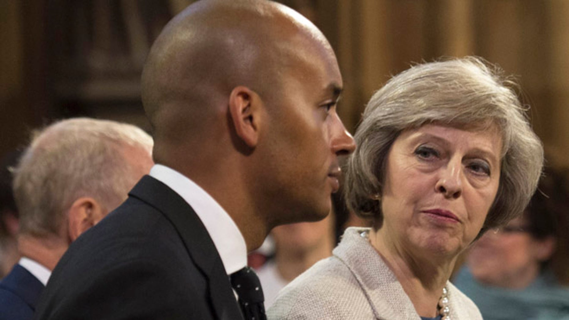 May 18, 2016: Home Secretary Theresa May and Labour MP Chuka Umunna pass through the Central Lobby for the State Opening of Parliament at the Palace of Westminster in London, Britain.