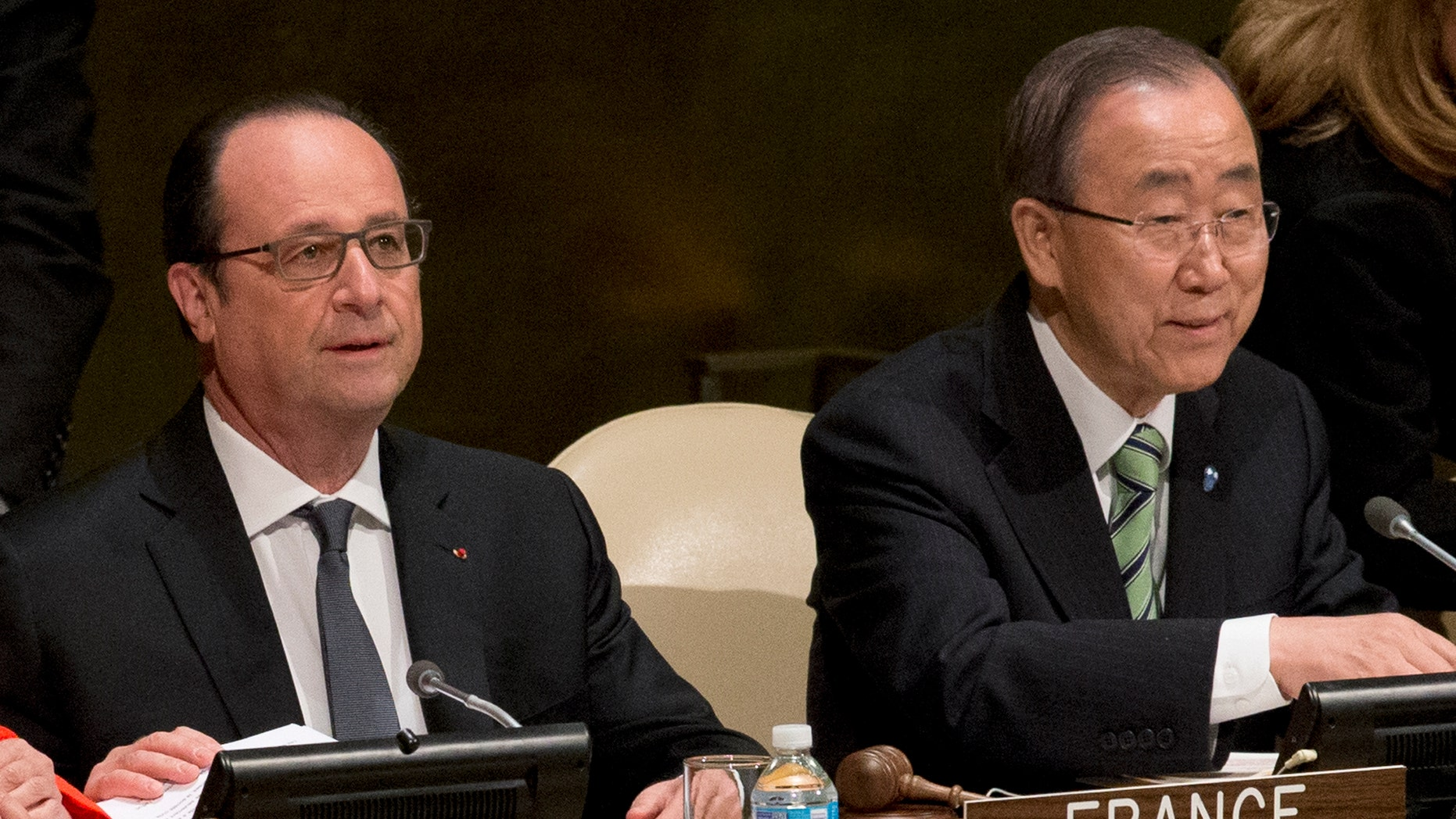 United Nations Secretary General Ban Ki-moon, right, and French President Francois Hollande attend the Paris Agreement on climate change ceremony, Friday, April 22, 2016 at U.N. headquarters. (AP Photo/Mary Altaffer)