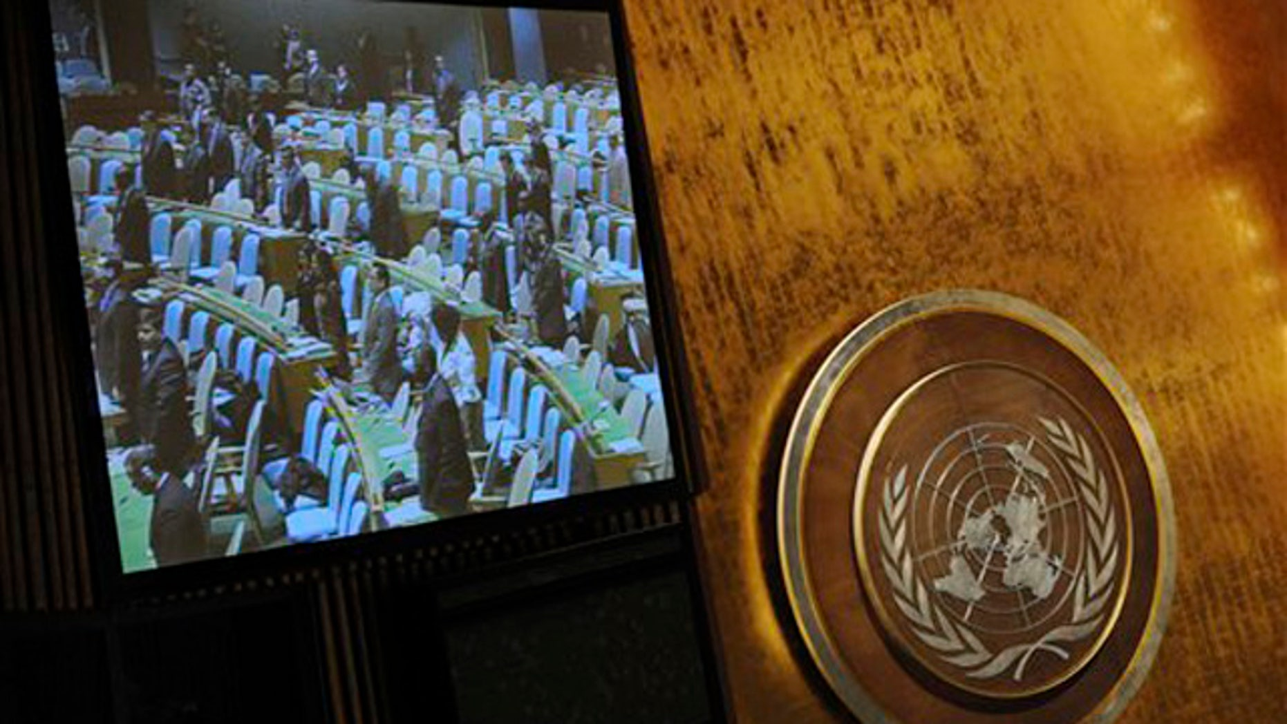 Dec. 22, 2011: In this photo released by China's Xinhua News Agency, the U.N. General Assembly observes a moment of silence to mourn the death of North Korean leader Kim Jong Il at the U.N. Headquarters in New York.