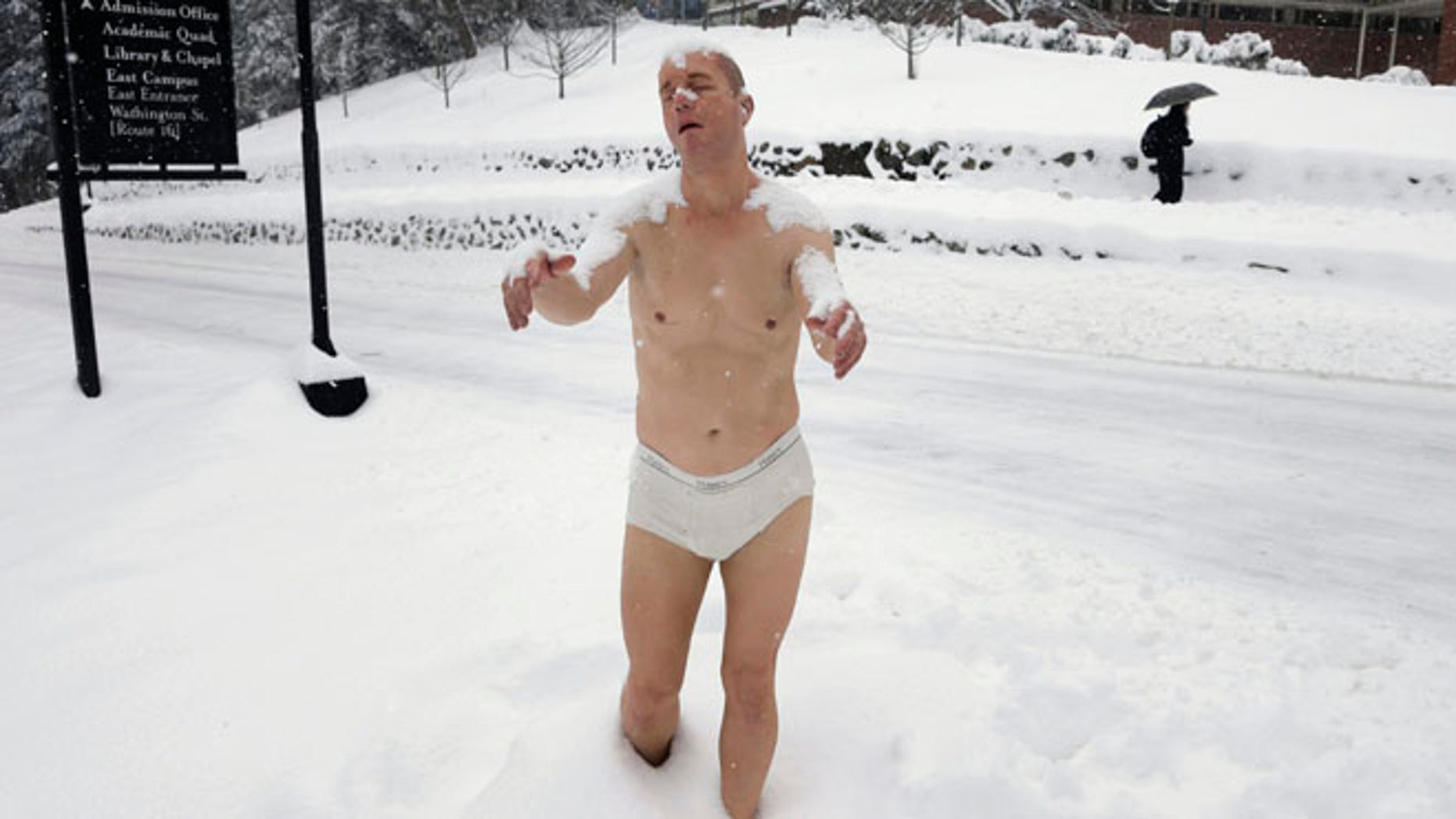 Feb. 5, 2014: A statue of a man sleepwalking in his underpants is surrounded by snow on the campus of Wellesley College, in Wellesley, Mass.