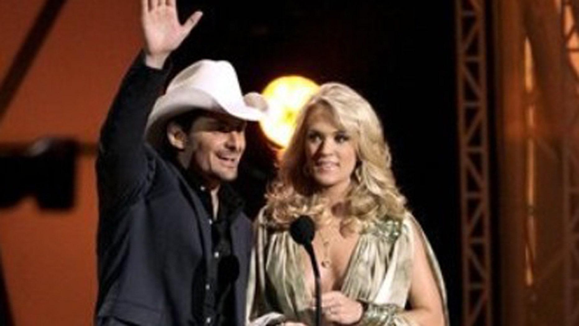 Nov. 9, 2011: Hosts Brad Paisley, left, and Carrie Underwood speak during the 45th Annual CMA Awards in Nashville, Tenn.