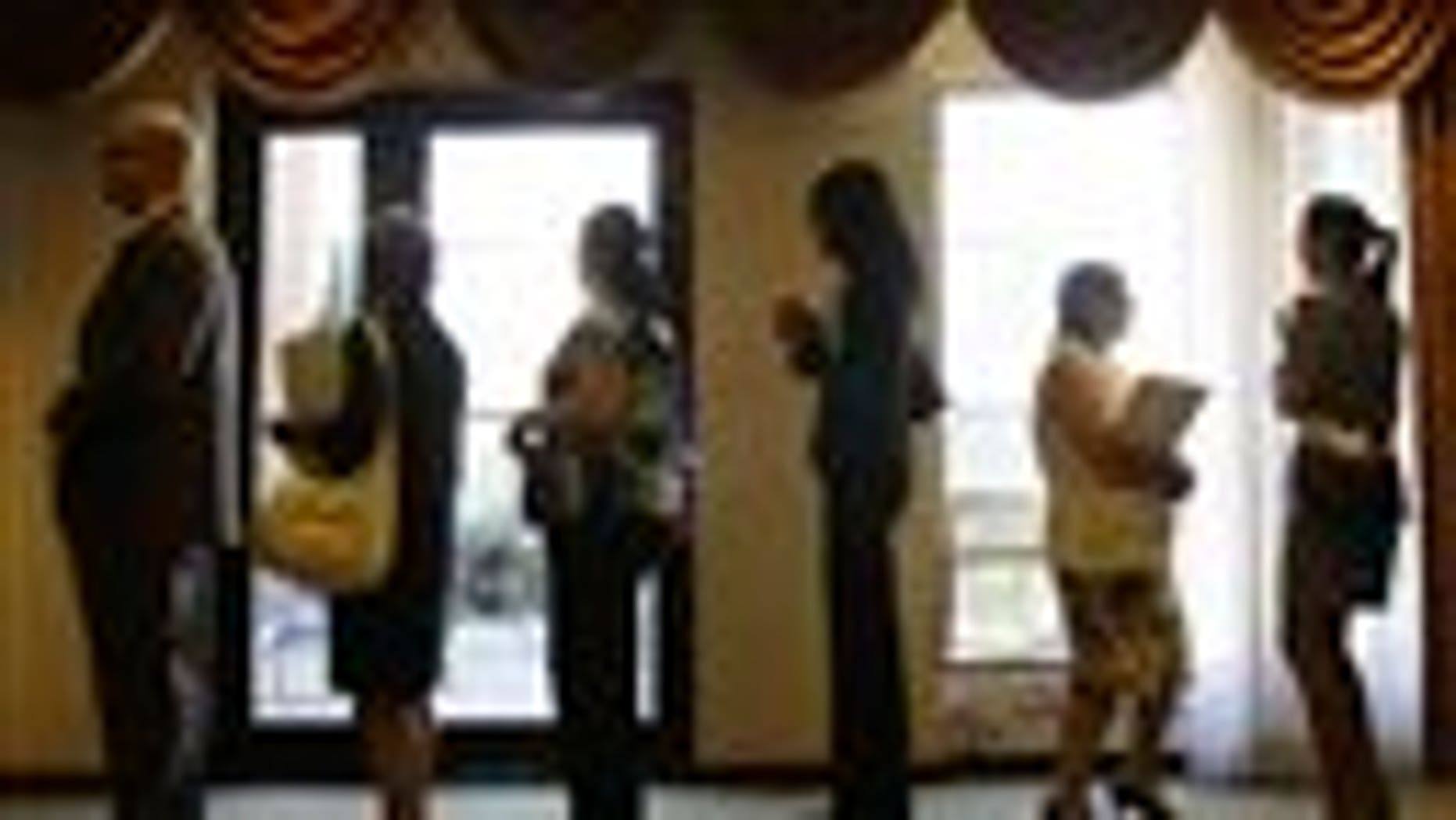 In this Aug. 16, 2011 photo, job seekers stand in line to enter a job fair, in Independence, Ohio.  The number of people applying for unemployment benefits rose back above 400,000 last week. Still, the average number of applications over the past four weeks fell to its lowest level since mid-April. That suggests the job market may be improving. (AP Photo/Tony Dejak)
