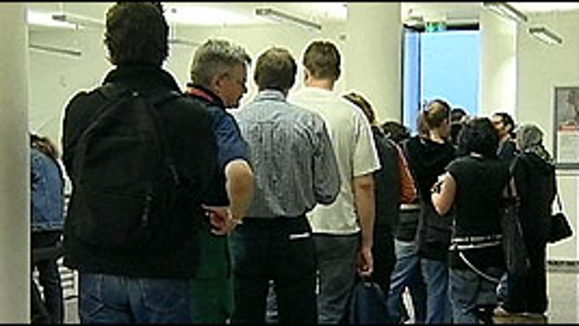 April 2011: Americans wait in line for unemployment benefits