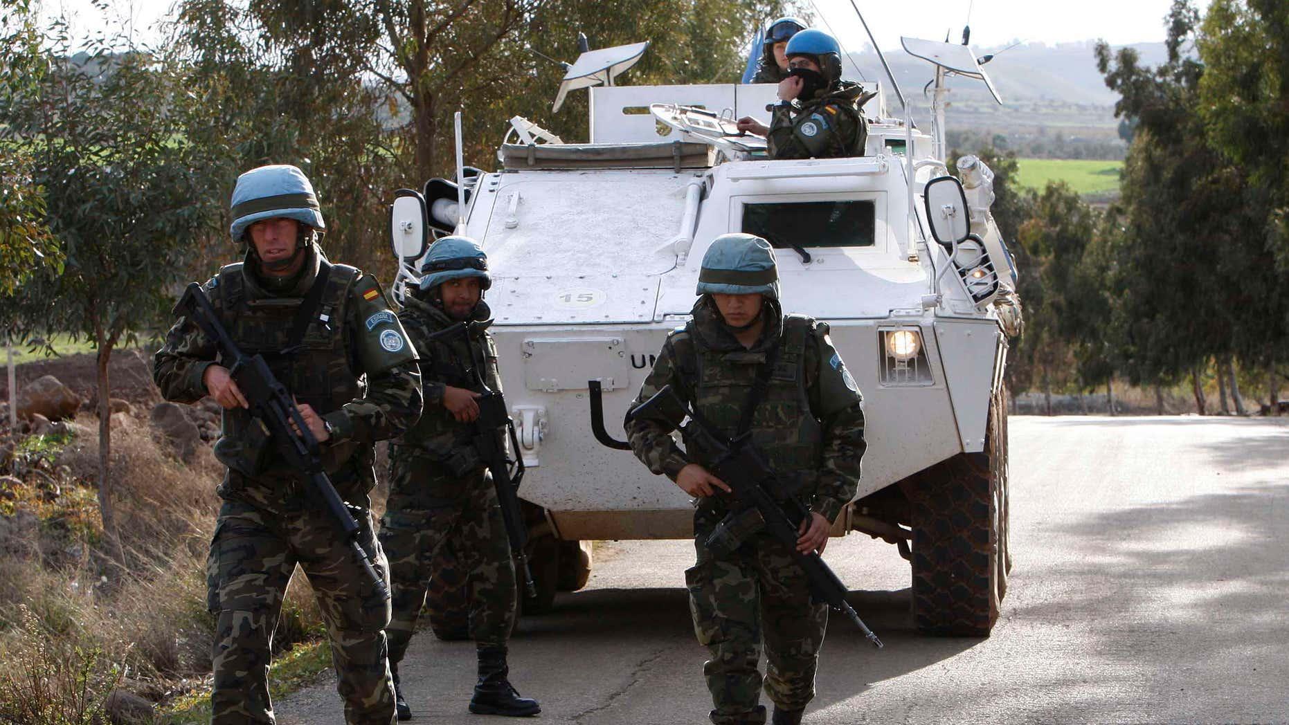 Jan. 14, 2009: Spanish U.N peacekeepers patrol the area where a rocket fell short in Lebanon several kilometers north of the Israeli border, near the village of el-Meri, southern Lebanon. Russia's aggressiveness in the east.