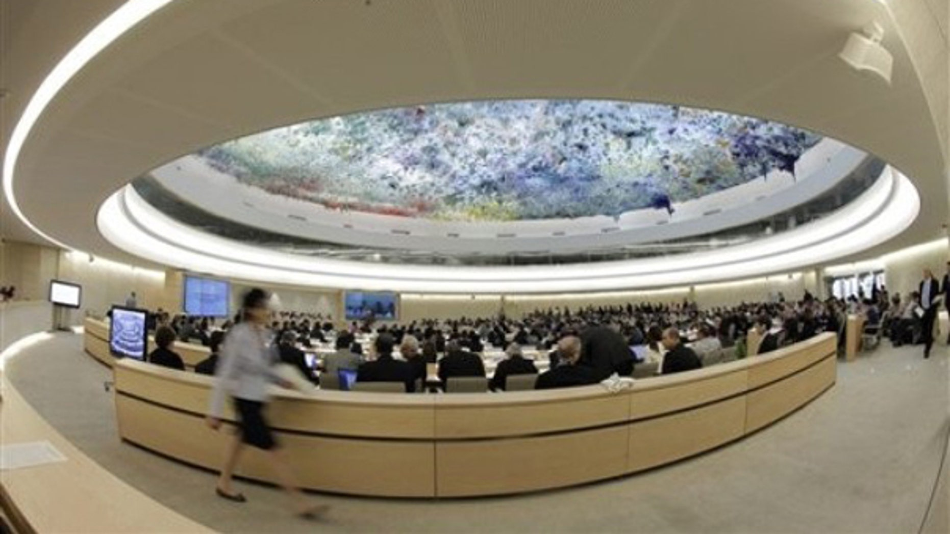 A woman walks past the Human Rights Council at the European headquarters of the United Nations in Geneva May 31. (AP Photo)