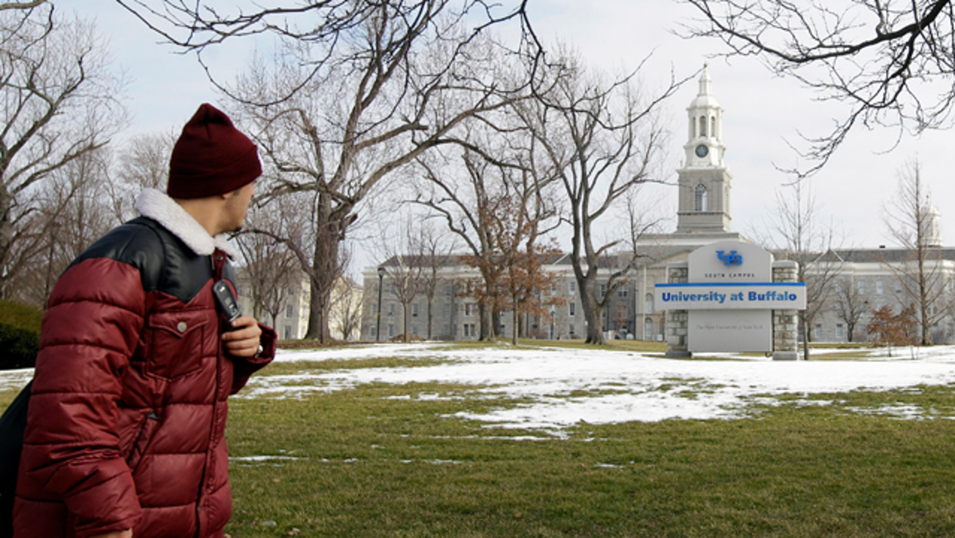 Feb. 15, 2012: A person walks on the University at Buffalo campus in Buffalo, N.Y. The New York Police Department monitored Muslim college students far more broadly than previously known, at schools far beyond the city limits, including the University at Buffalo, the Ivy League colleges of Yale and the University of Pennsylvania, The Associated Press has learned.