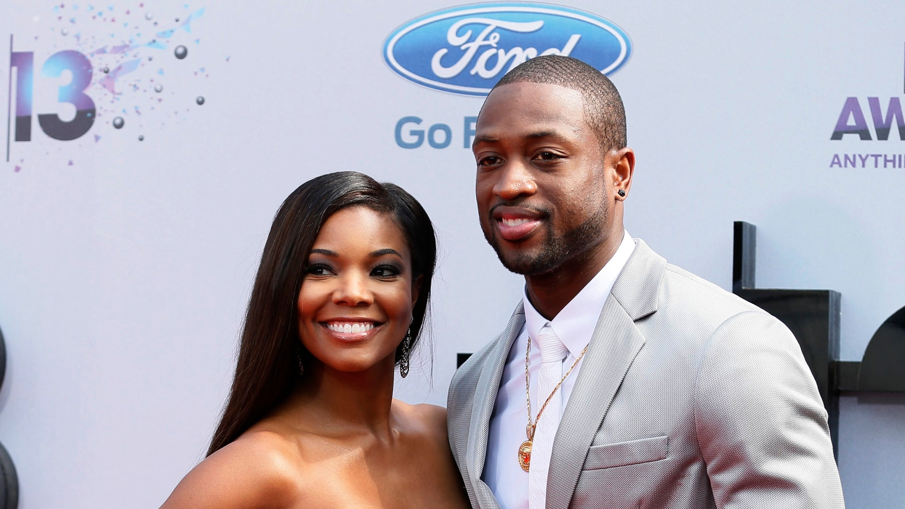 June 30, 2013. NBA star Dwyane Wade and actress Gabrielle Union arrive at the 2013 BET Awards in Los Angeles, California.