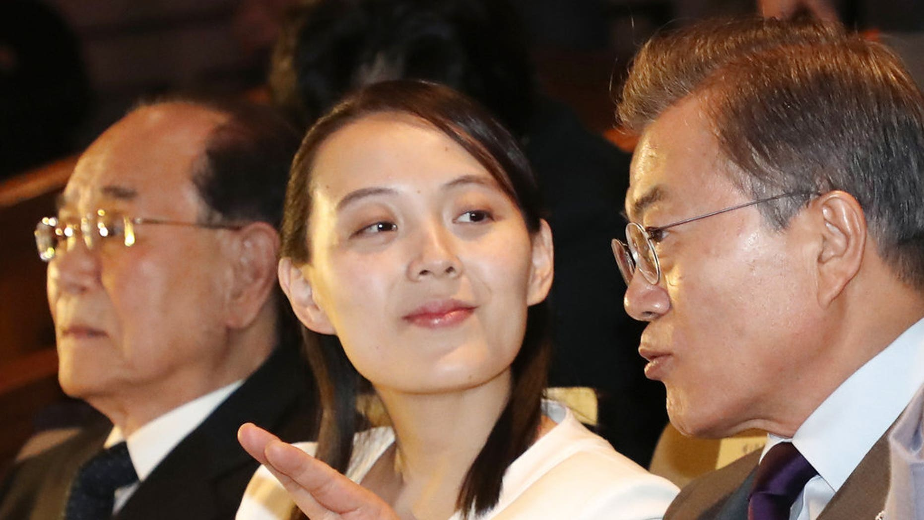 """South Koran President Moon Jae-in talks with Kim Yo Jong, North Korean leader Kim Jong Un's sister, during a performance of North Korea's Samjiyon Orchestra at National Theater in Seoul, South Korea, Sunday, Feb. 11, 2018. A rare invitation to Pyongyang for South Korea's president marked Day Two of the North Korean Kim dynasty's southern road tour, part of an accelerating diplomatic thaw that included some Korean liquor over lunch and the shared joy of watching a """"unified"""" Korea team play hockey at the Olympics. At left is North Korea's nominal head of state Kim Yong Nam. (Bee Jae-man/Yonhap via AP)"""