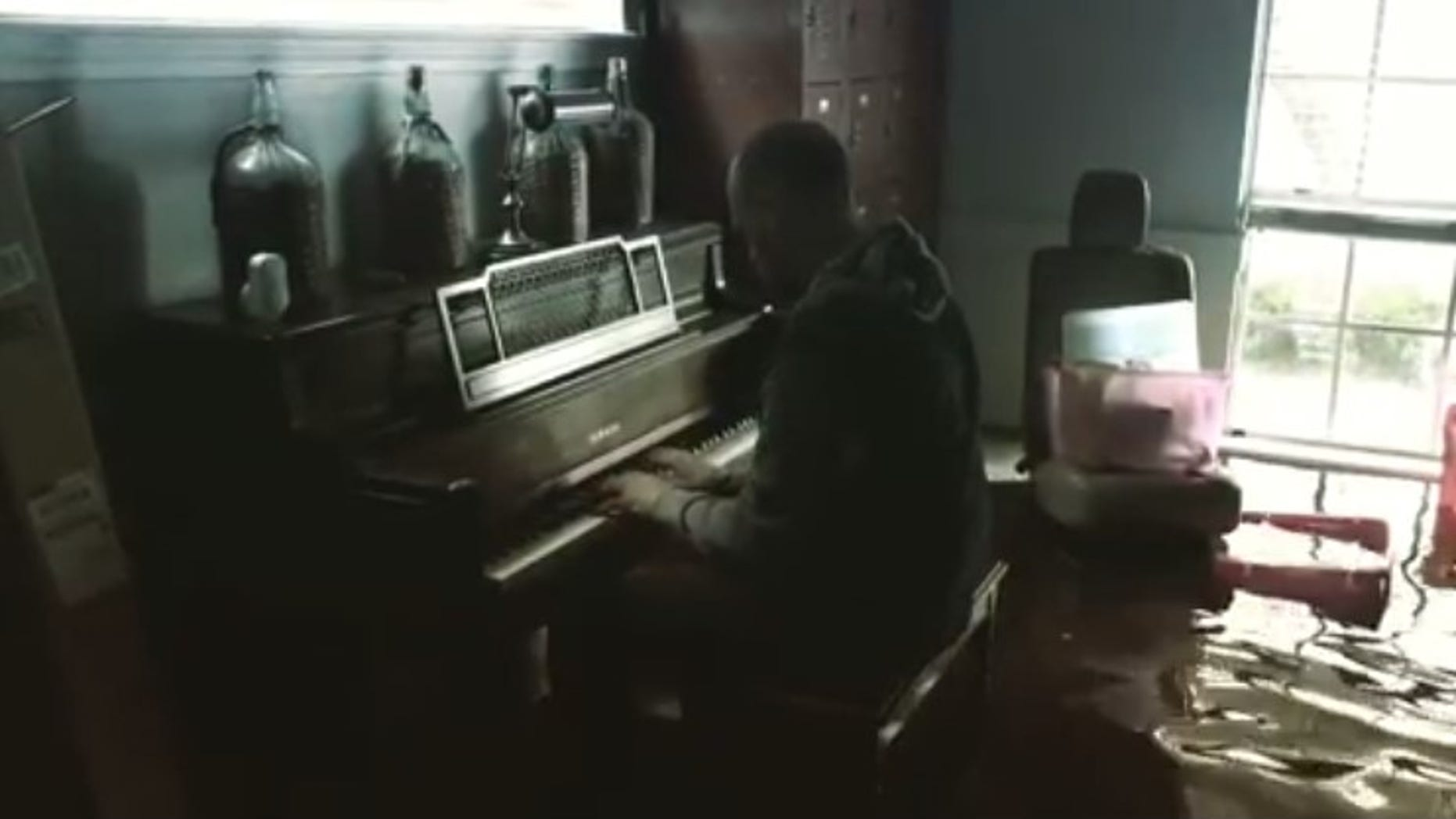 Texas resident Aric Harding posted a video to Instagram of him playing the piano in knee-deep water.