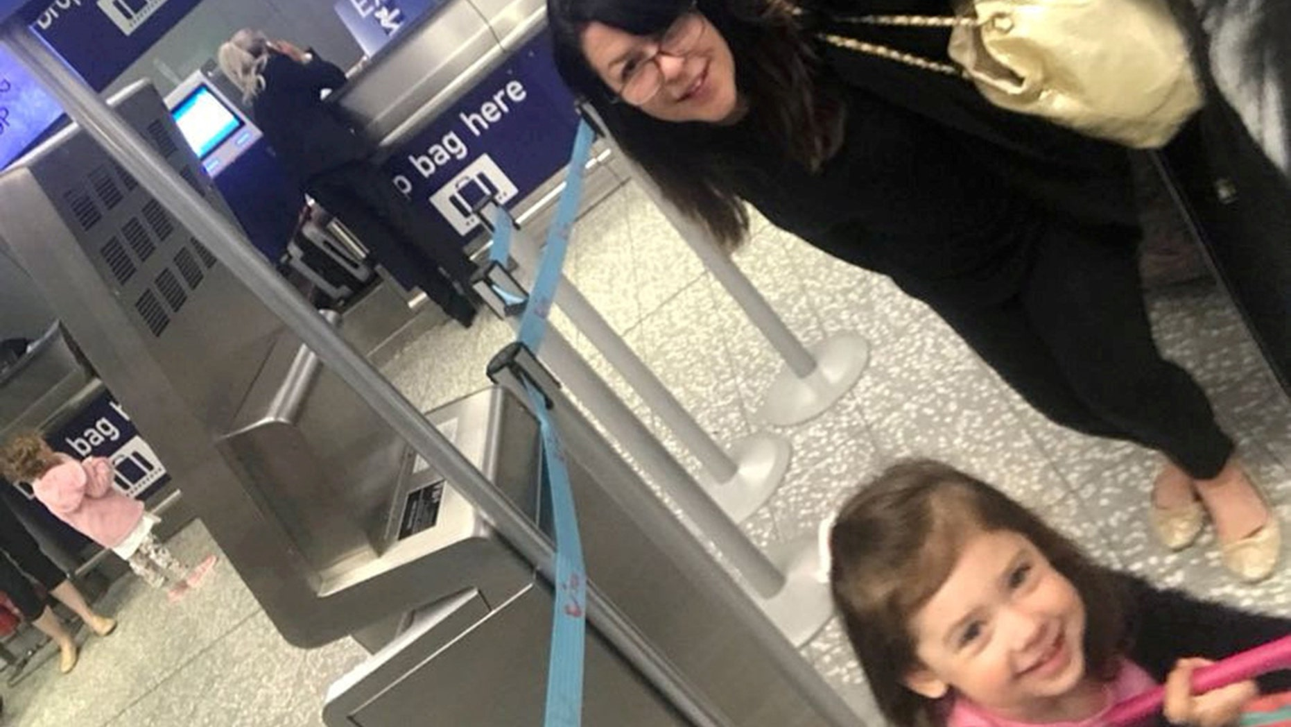 Hayley Lewis, 28, was about to embark on daughter Sydney's first-ever flight along with other family members when an airport worker refused to let her pass because of a ripped page in her passport book.