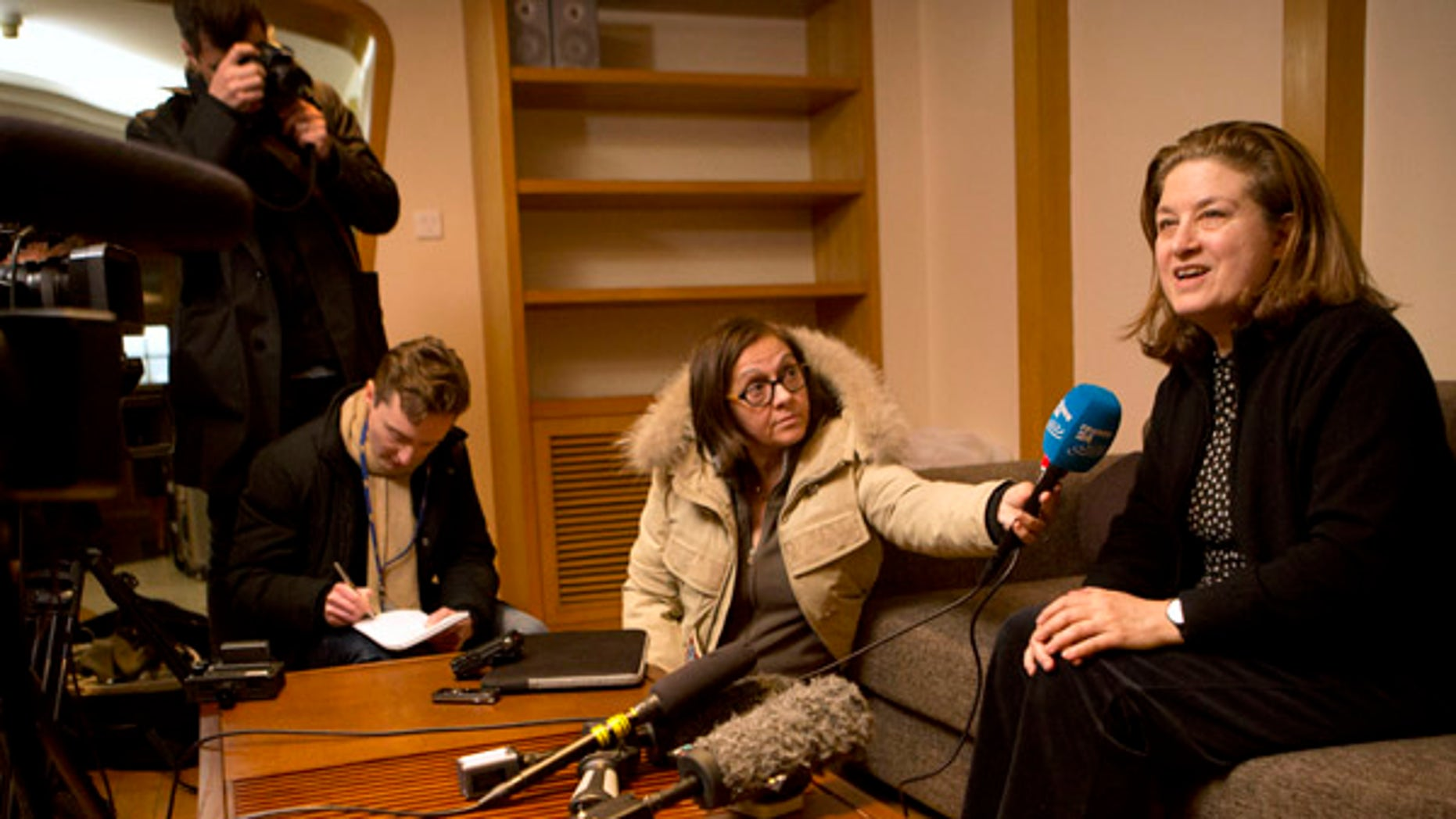 Dec. 31, 2015: French journalist Ursula Gauthier, right, a reporter in China for the French news magazine L'Obs, speaks to the media in her apartment before leaving for the airport in Beijing (AP)