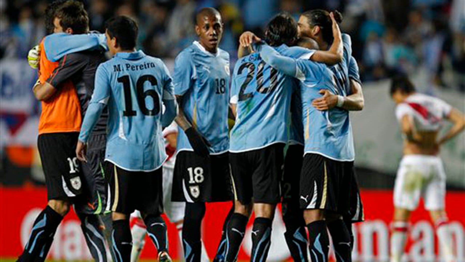 Uruguay's players celebrate at the end of a Copa America semifinal soccer match with Peru in La Plata, Argentina, Tuesday, July 19, 2011. Uruguay won the match 2-0 and advanced to the final. (AP Photo/Ricardo Mazalan)