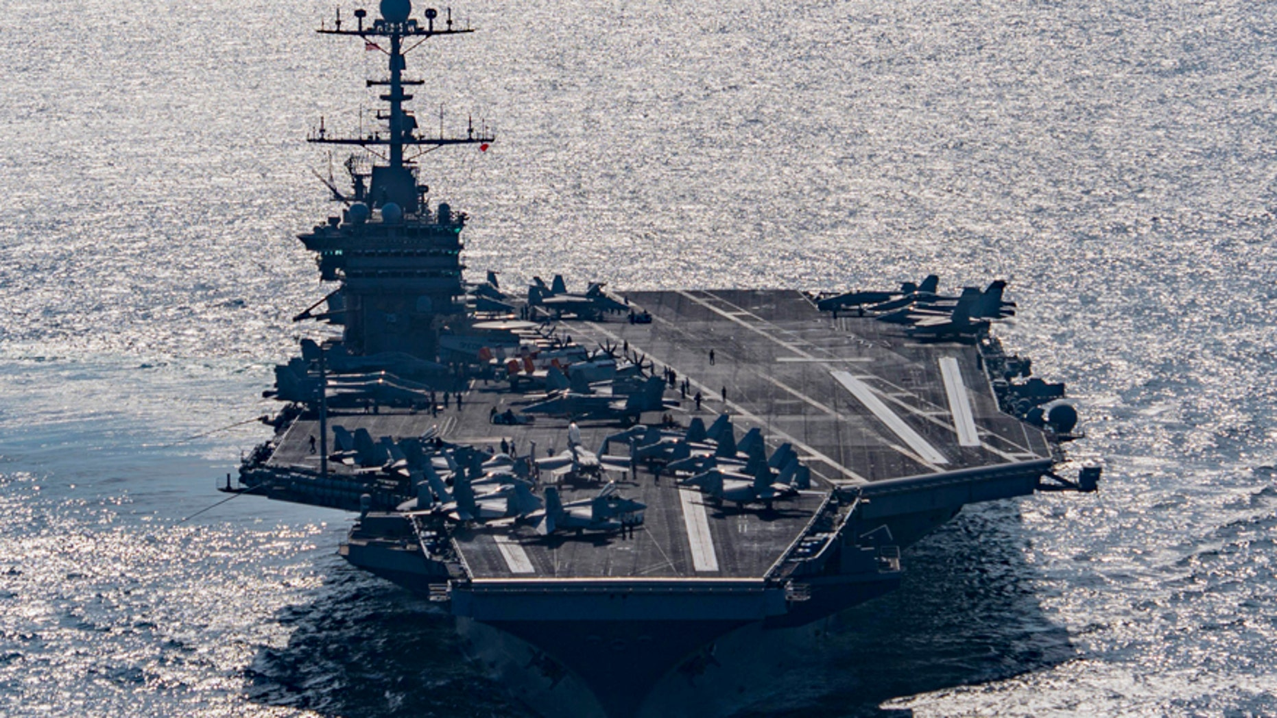 The aircraft carrier USS Harry S. Truman navigates the Gulf of Oman.