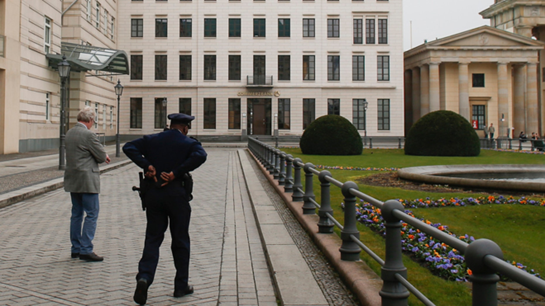 April 16, 2013: In this file photo, United States security officers patrol in front of the  U.S. embassy in Berlin, Germany. Germany took the dramatic step Thursday of asking the top U.S. intelligence official in Berlin to leave the country, following two reported cases of suspected U.S. spying and the yearlong spat over eavesdropping by the National Security Agency.