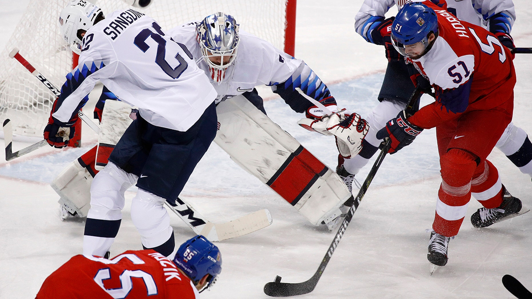 Roman Horak (51), of the Czech Republic, takes a shot at goalie Ryan Zapolski (30), of the United States, during the first period of the quarterfinal round of the men's hockey game at the 2018 Winter Olympics in Gangneung, South Korea, Wednesday, Feb. 21, 2018. (AP Photo/Jae C. Hong)