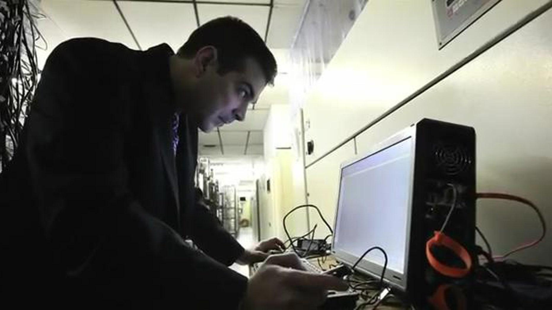 March 23, 2012: Digital forensic examiner Ashim Kapur disables a computer running the Zeus botnet in Scranton, PA.