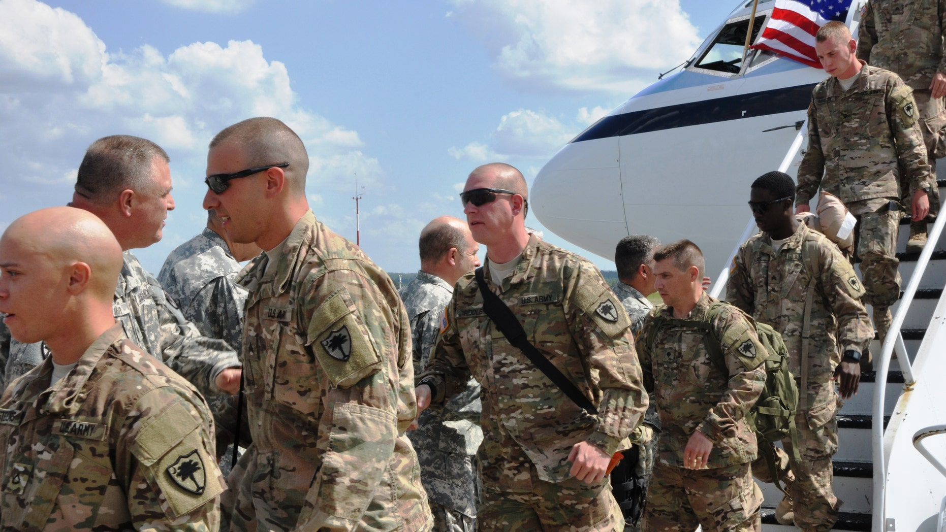 May 14, 2014:  U.S. Army Soldiers in the 1223rd Engineer Company, S.C. Army National Guard returning to Columbia, SC.