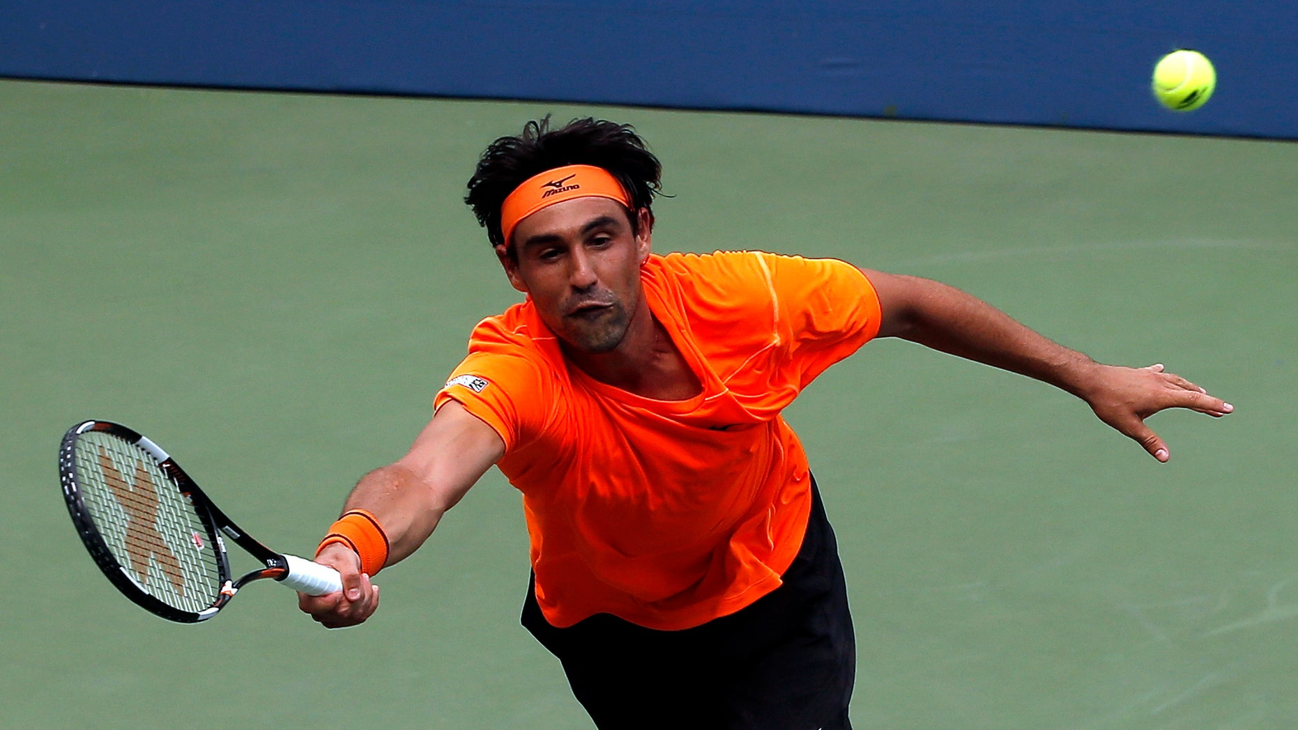 Marcos Baghdatis returns a shot at the U.S. Open.