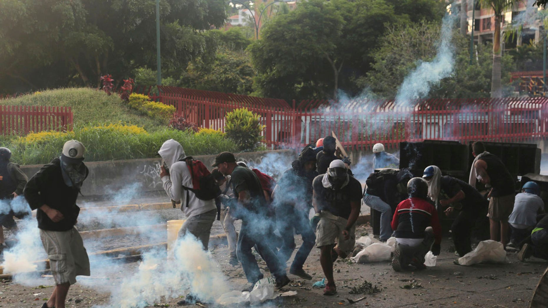 Demonstrators clash with the Bolivarian National Guard, at El Hatillo municipality outside Caracas, Venezuela, Tuesday, May 2, 2017.