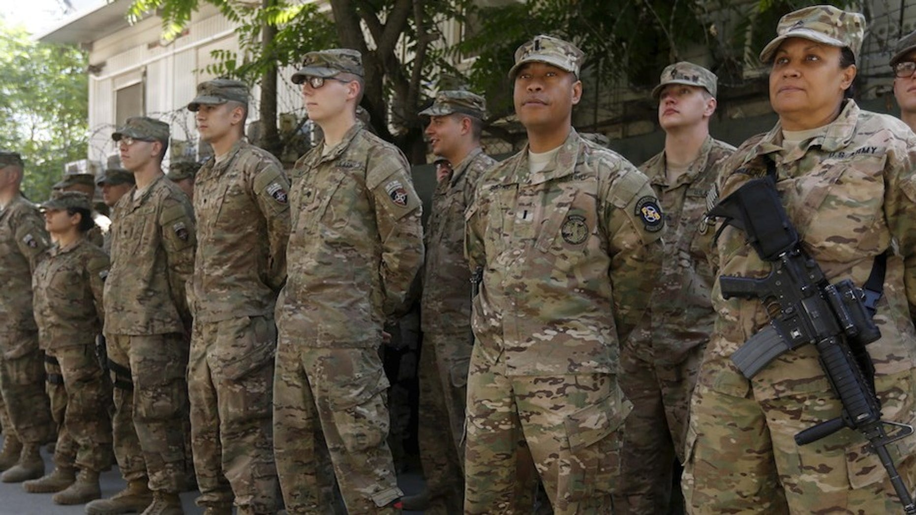 U.S. troops attend a ceremony to commemorate Memorial Day in Kabul, May 25, 2015. Memorial Day is observed annually in the U.S. on the last Monday of May to honor the nation's fallen members of the military. (REUTERS/Omar Sobhani)