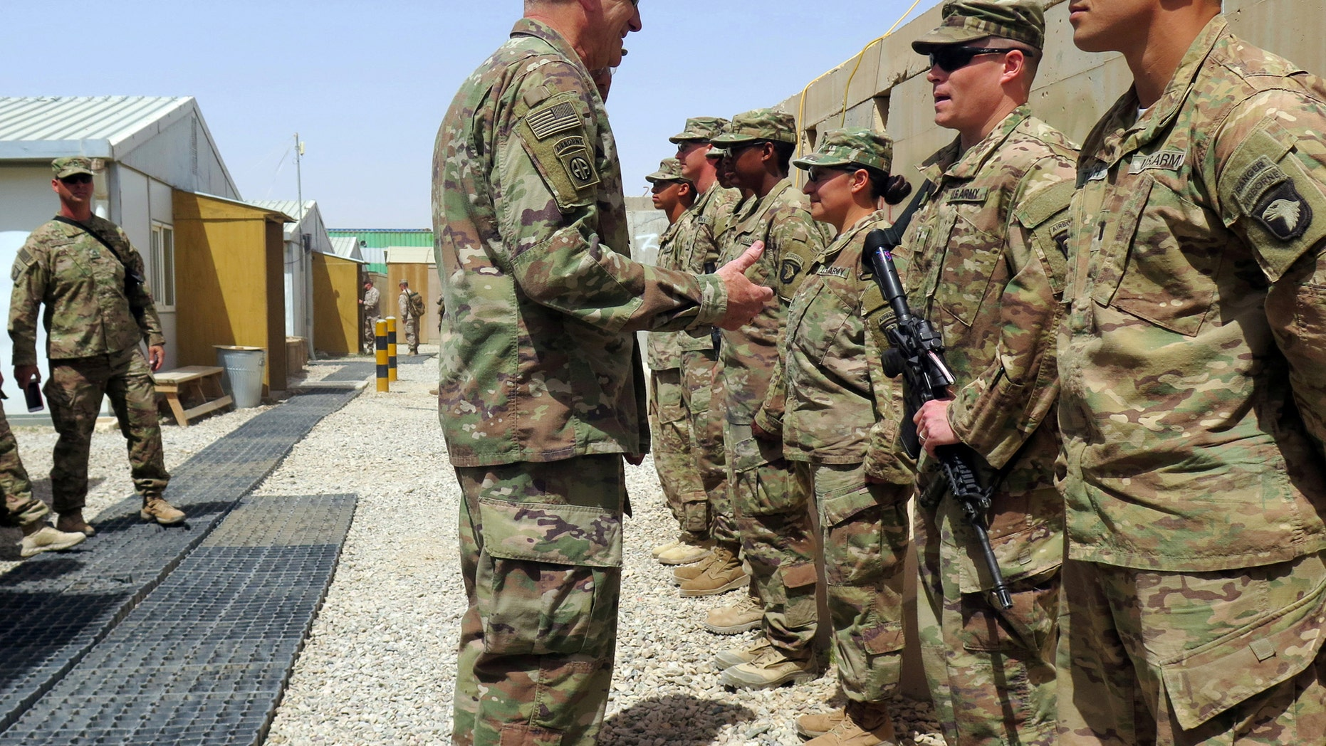U.S. Army General John Nicholson, commander of Resolute Support forces and U.S. forces in Afghanistan, talks to U.S. soldiers during a transfer of authority ceremony at Shorab camp, in Helmand province, Afghanistan April 29, 2017. Picture taken April 29, 2017. REUTERS/James Mackenzie - RTS14IL2