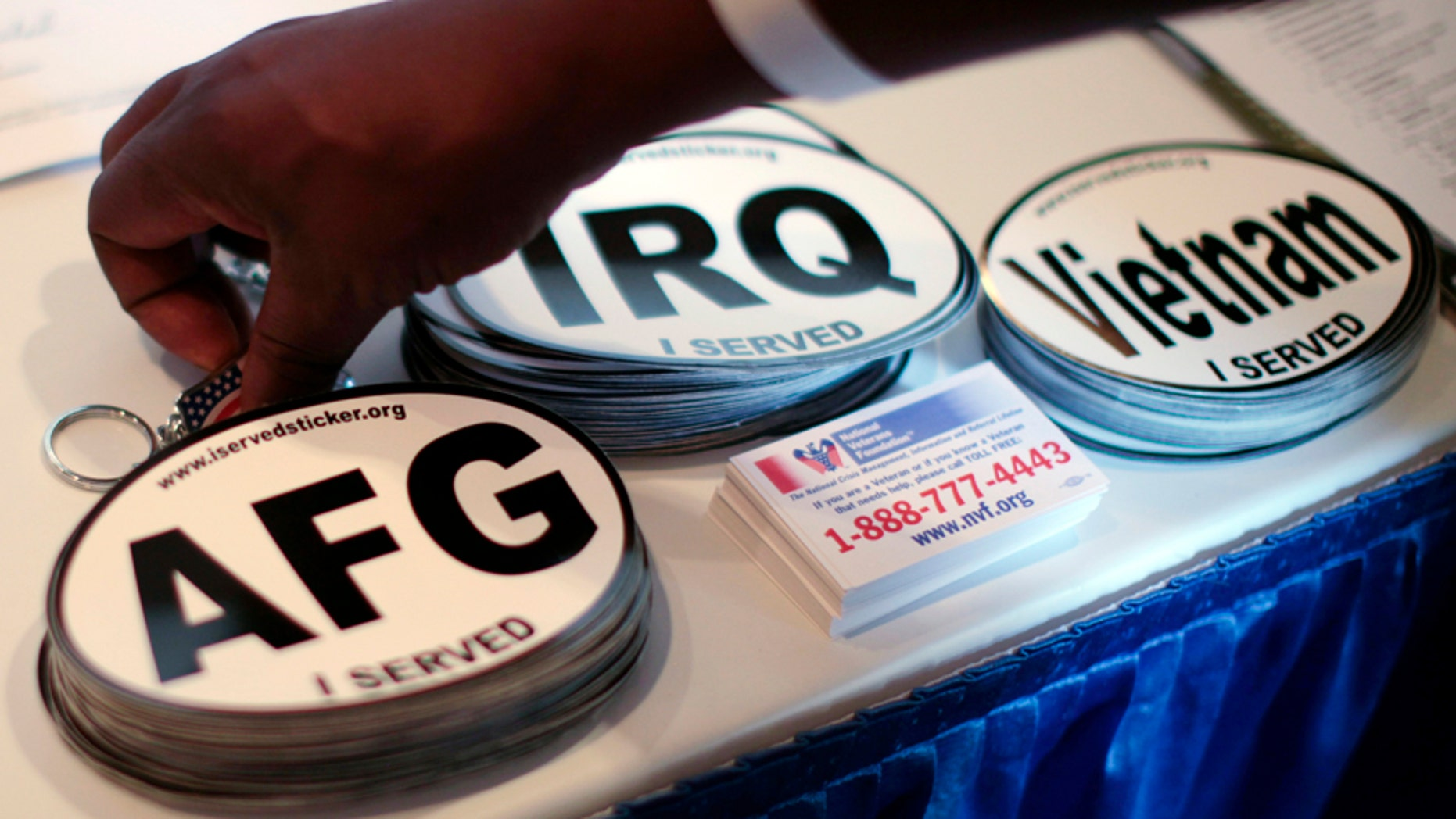 Car stickers commemorating U.S. military service in Vietnam, Afghanistan and Iraq are seen on a recruiter's table at a veterans job fair in Los Angeles, California November 10, 2010. REUTERS/Lucy Nicholson (UNITED STATES - Tags: EMPLOYMENT BUSINESS) - GM1E6BB0KP901