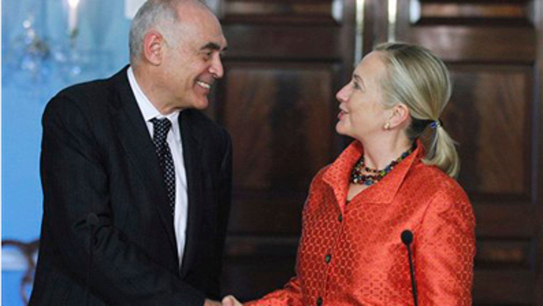 Sept. 28: Secretary of State Hillary Rodham Clinton shakes hands with Egyptian Foreign Affairs Minister Mohamed Kamel Amr during a joint news conference following a bilateral meeting at the State Department in Washington.