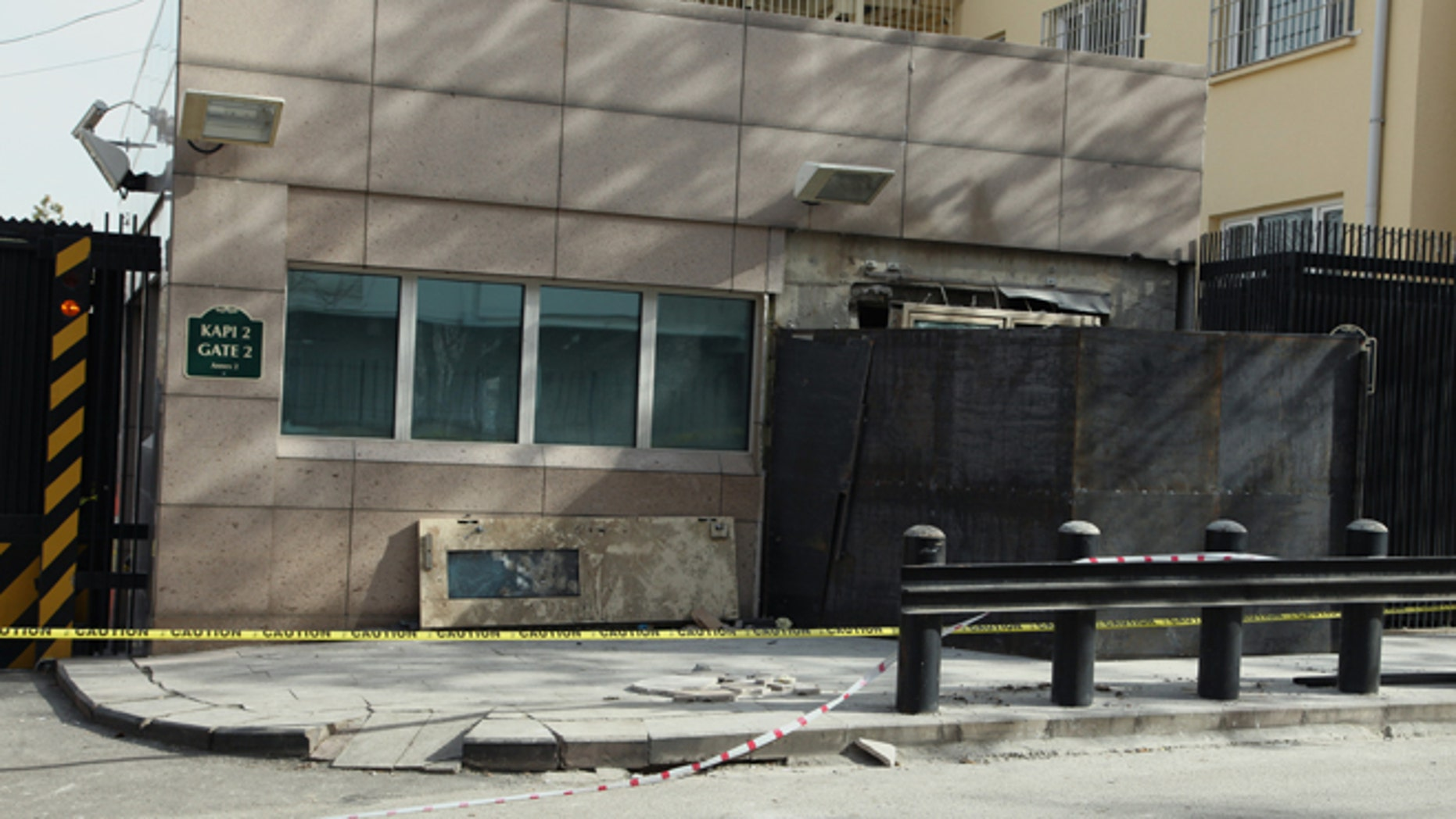Feb. 4, 2013: The side entrance of the U. S. embassy, closed with metal sheeting, three days after a suicide bomber attack, in Ankara, Turkey. The suicide bomber who struck the U.S. Embassy in Ankara spent five years in prison on terrorism charges but was released after being diagnosed with a hunger strike-related brain disorder, officials said Saturday.