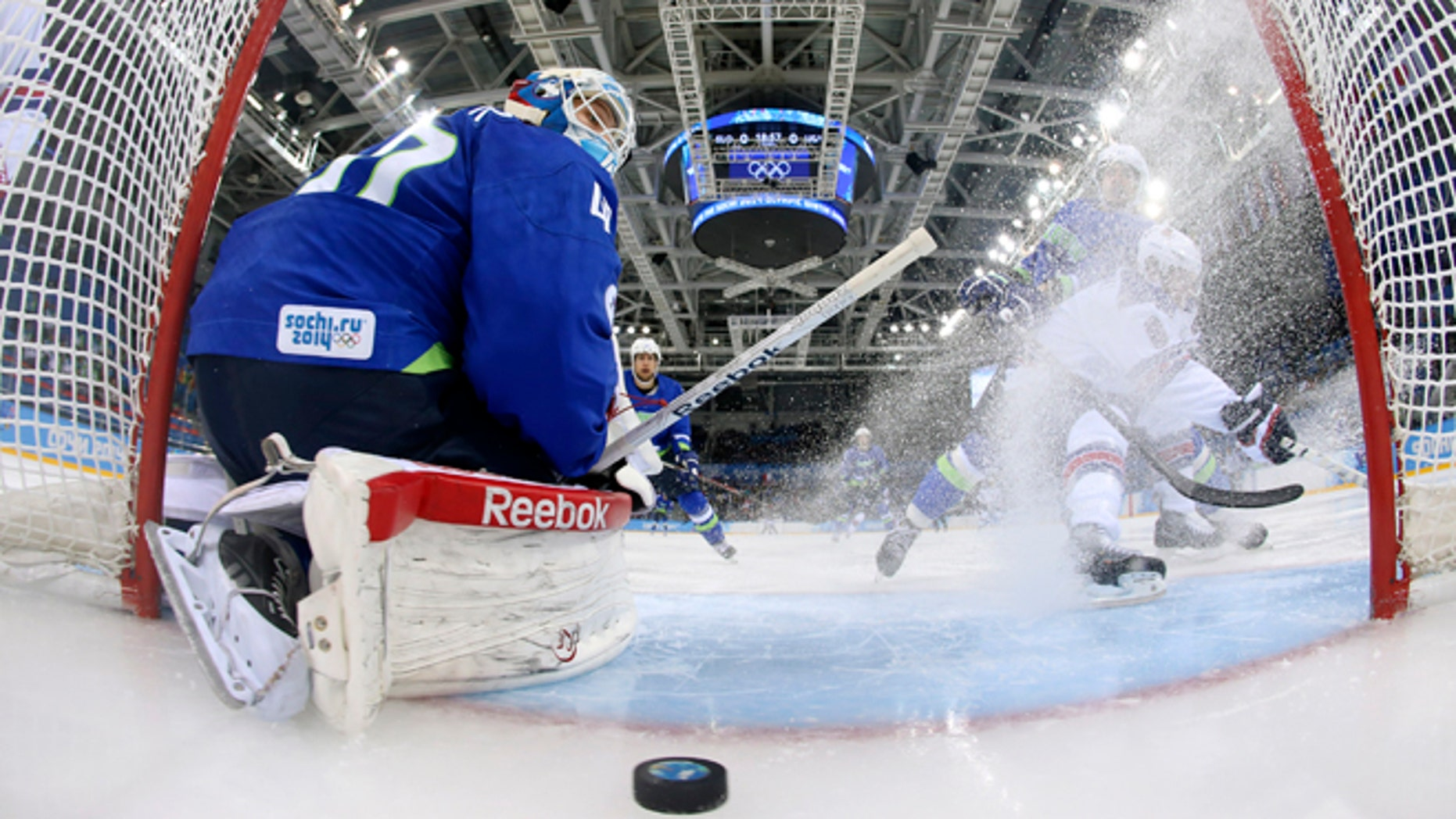 Feb. 16, 2014: Slovenia goaltender Luka Gracnar looks back at the puck after USA forward Phil Kessel scored period of a men's ice hockey game at the 2014 Winter Olympics, Sunday, Feb. 16, 2014, in Sochi, Russia.