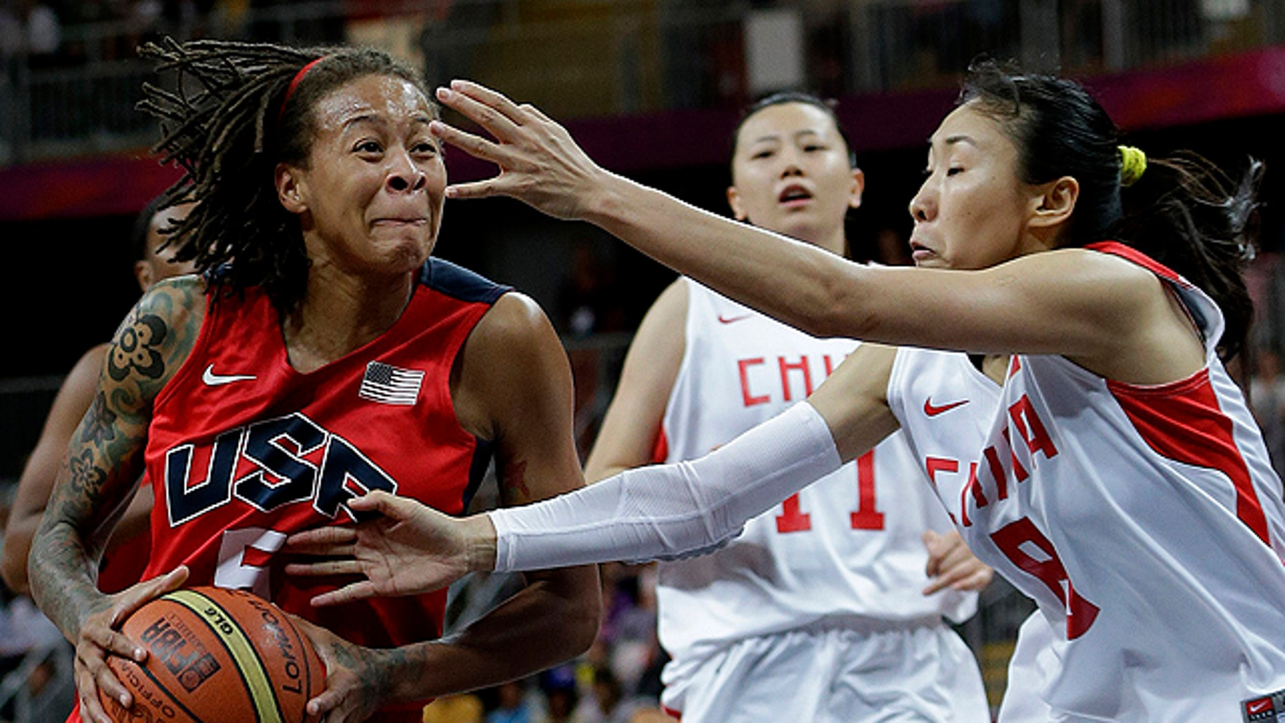 Aug. 5: USA's Seimone Augustus, left, drives past China defenders Miao Lijie (8) and Ma Zengyu (11) during a preliminary women's basketball game at the 2012 Summer Olympics. Team USA will meet France on Saturday for a chance to take home gold. (AP)