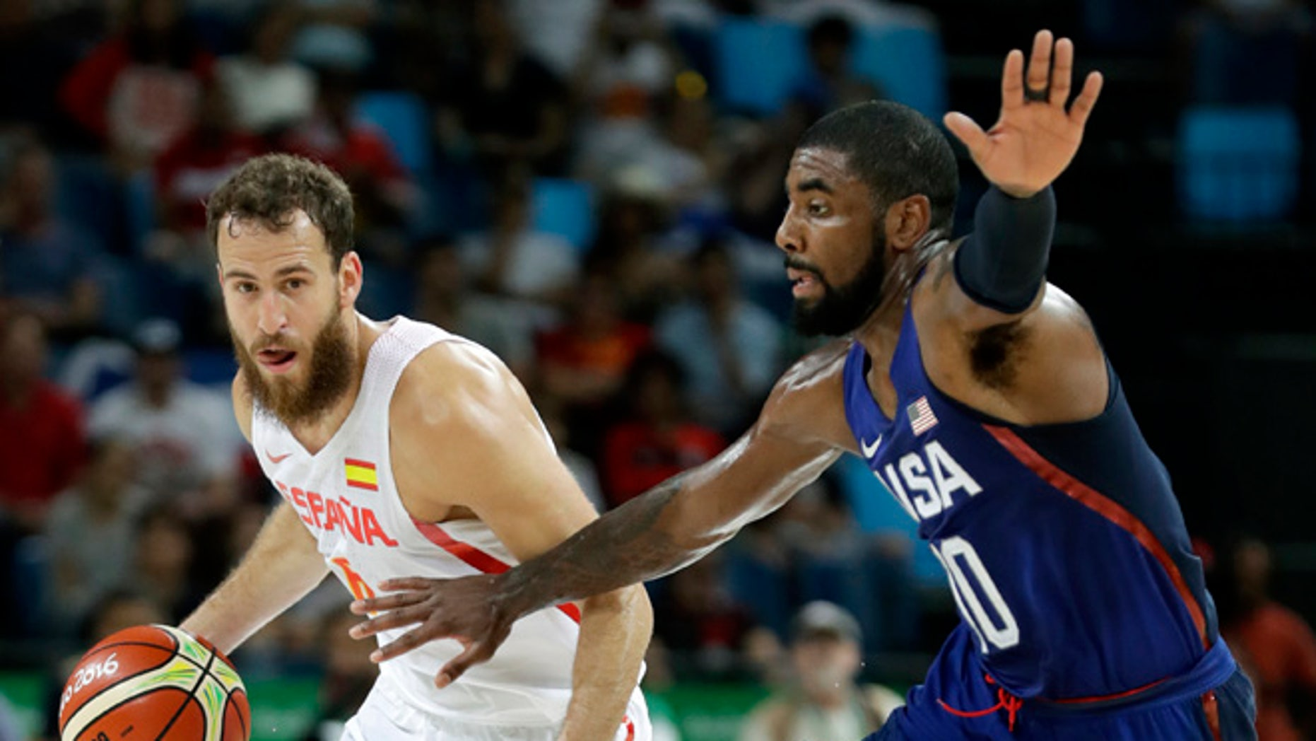Spain's Sergio Rodriguez, left, drives up court past United States' Kyrie Irving, right, during a semifinal round basketball game at the 2016 Summer Olympics in Rio de Janeiro, Brazil, Friday, Aug. 19, 2016. (AP Photo/Charlie Neibergall)