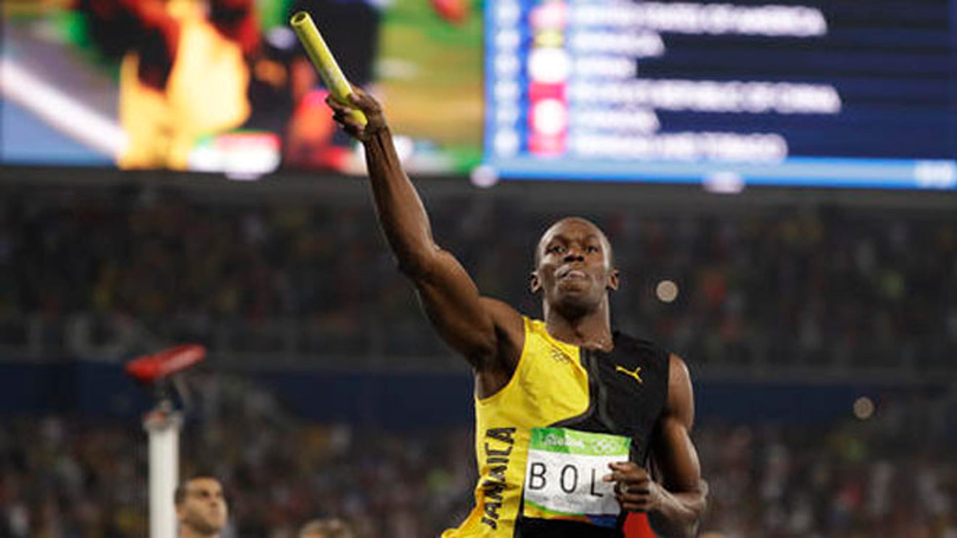Jamaica's Usain Bolt celebrates winning the gold medal in the men's 4x100-meter relay final Friday at the 2016 Summer Olympics in Rio de Janeiro