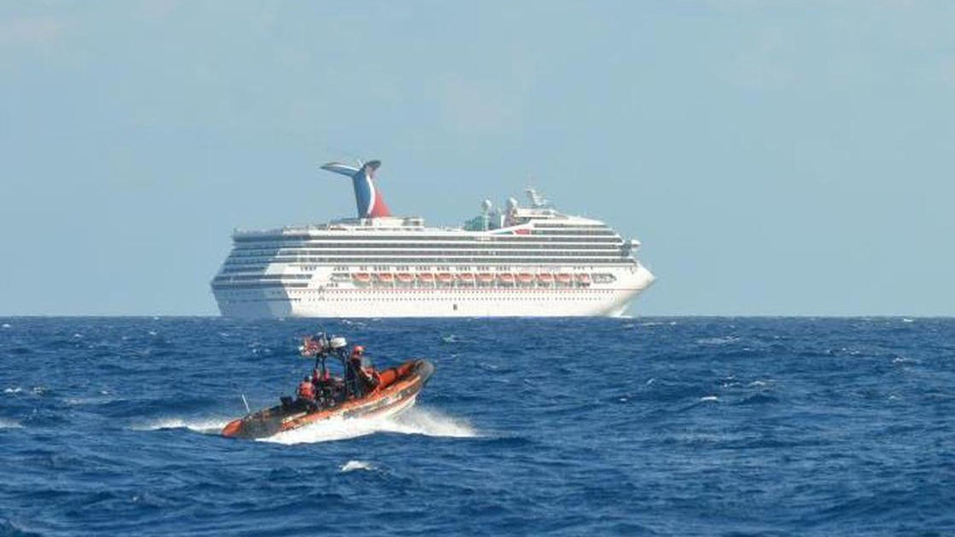 The Triumph cruise ship, set adrift in the Gulf of Mexico after an engine room fire Sunday, is being towed to Mobile, Alabama. The Carnival cruise ship line has cancelled the ship's next 14 voyages.