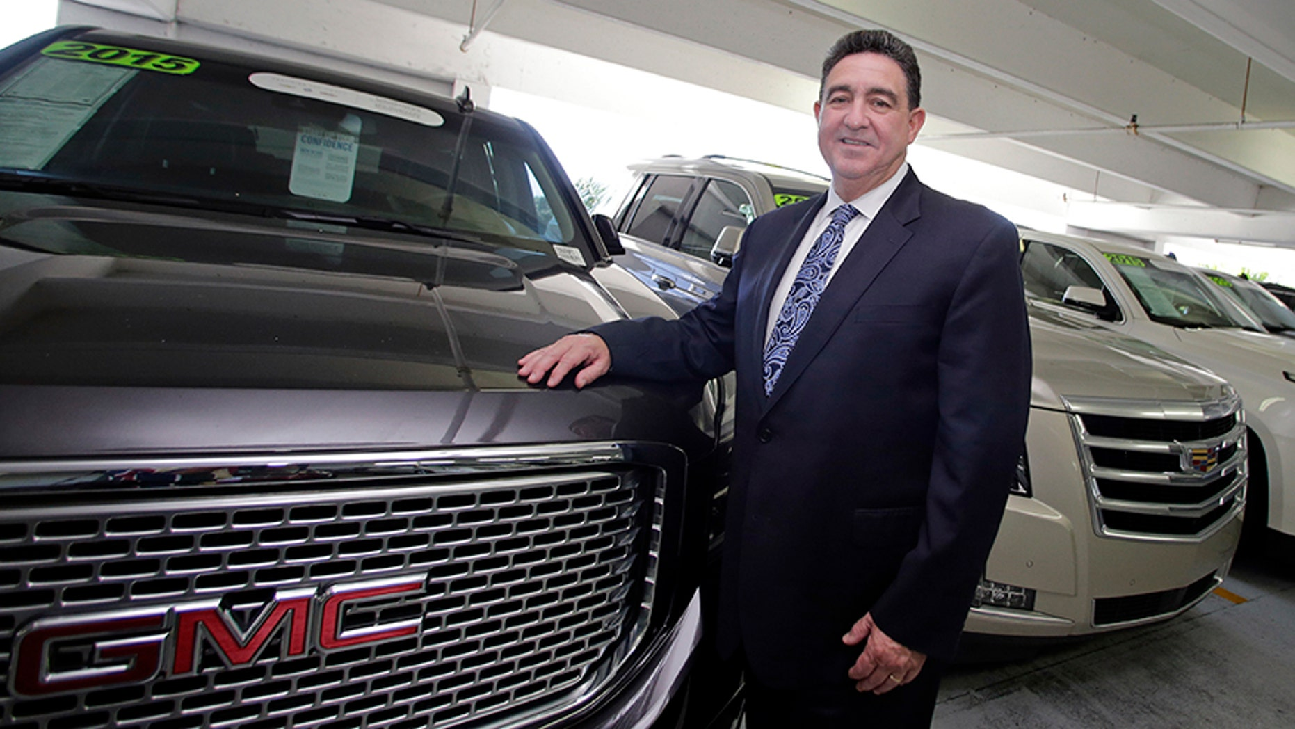 General sales manager Beny Ledesma poses for a photo at Williamson Cadillac Buick GMC dealership in Miami.