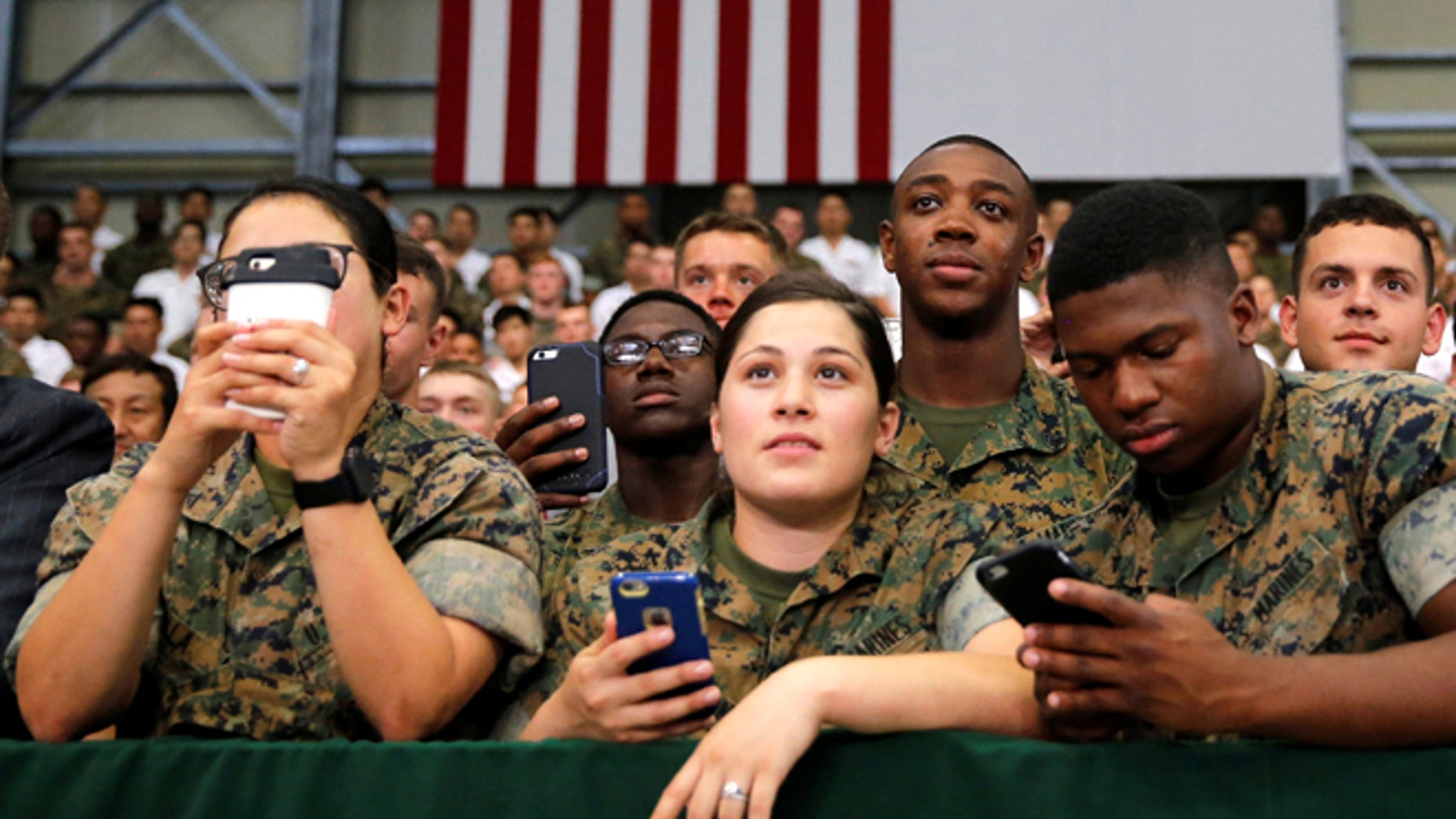 May 27, 2016: U.S. and Japan Self-Defence Force's soldiers listen to a speech by President Obama during his visit at Iwakuni Marine Corps Air Station, Japan. (Reuters)