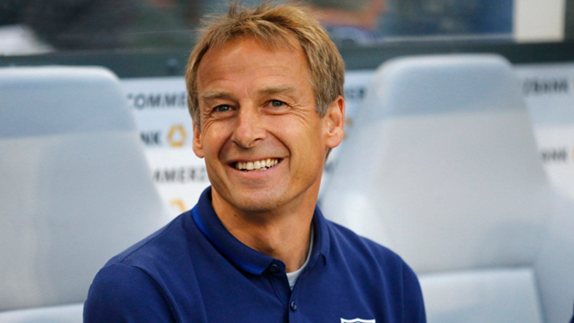 FILE - In this June 10, 20165 file picture United States' head coach Juergen Klinsmann smiles prior to the friendly soccer match between Germany and the United States in Cologne, Germany.