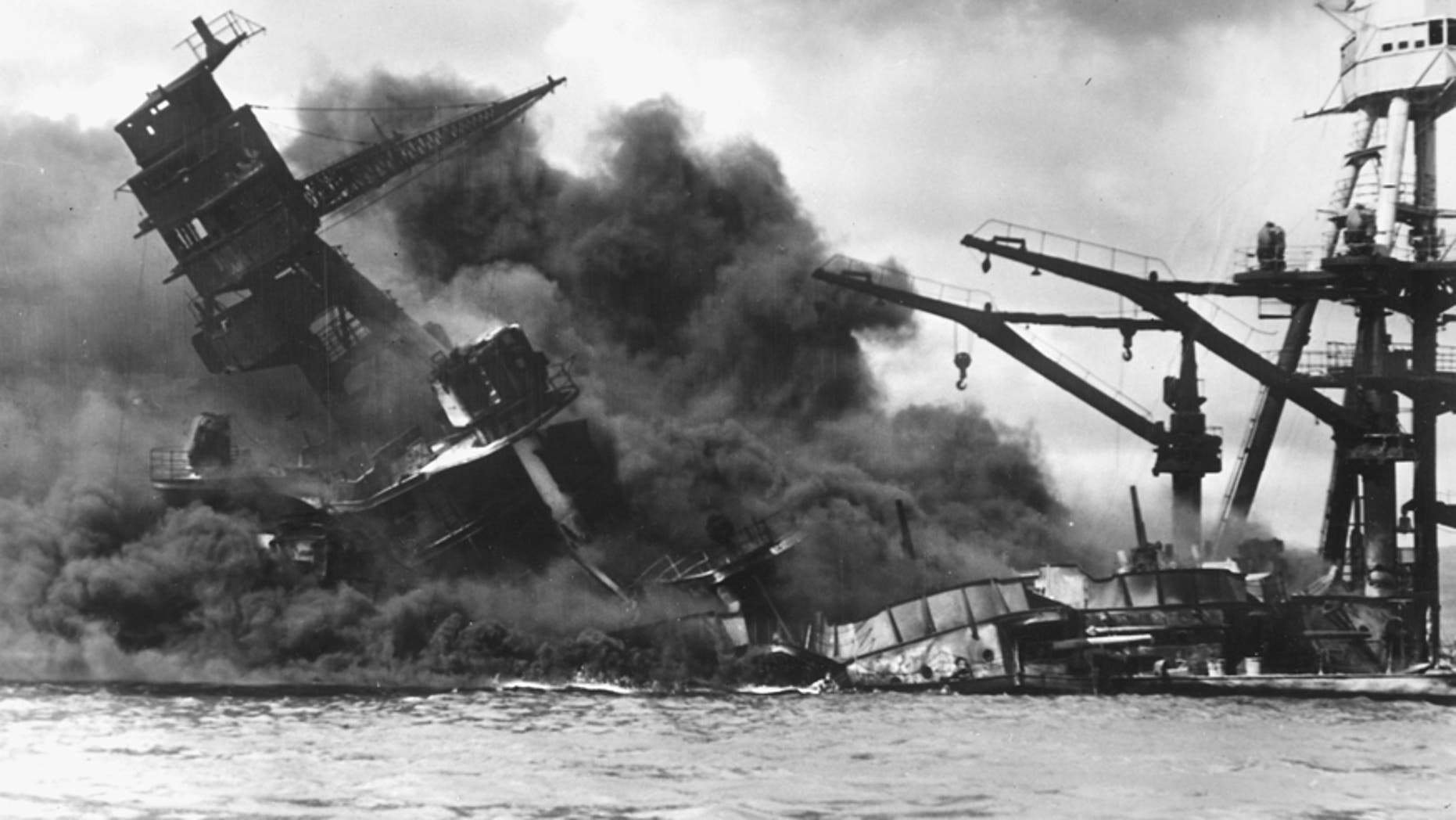 Dec. 7, 1941: The battleship USS Arizona sinks after being hit by a Japanese air attack on Pearl Harbor, Hawaii.
