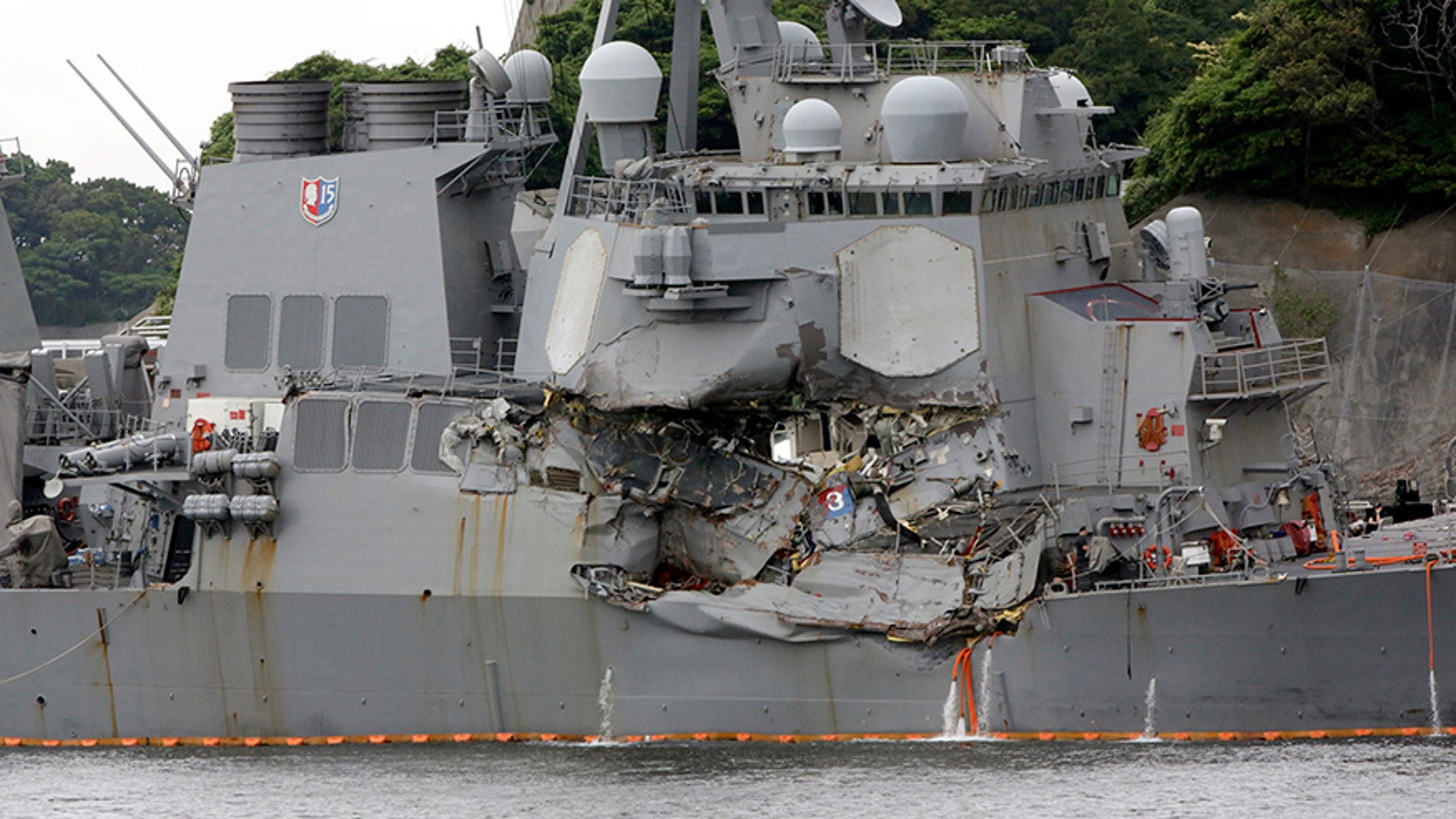 June 18, 2017: The damaged USS Fitzgerald is docked at the U.S. Naval base in Yokosuka, southwest of Tokyo after colliding with Philippine-flagged container ship ACX Crystal off Japan.