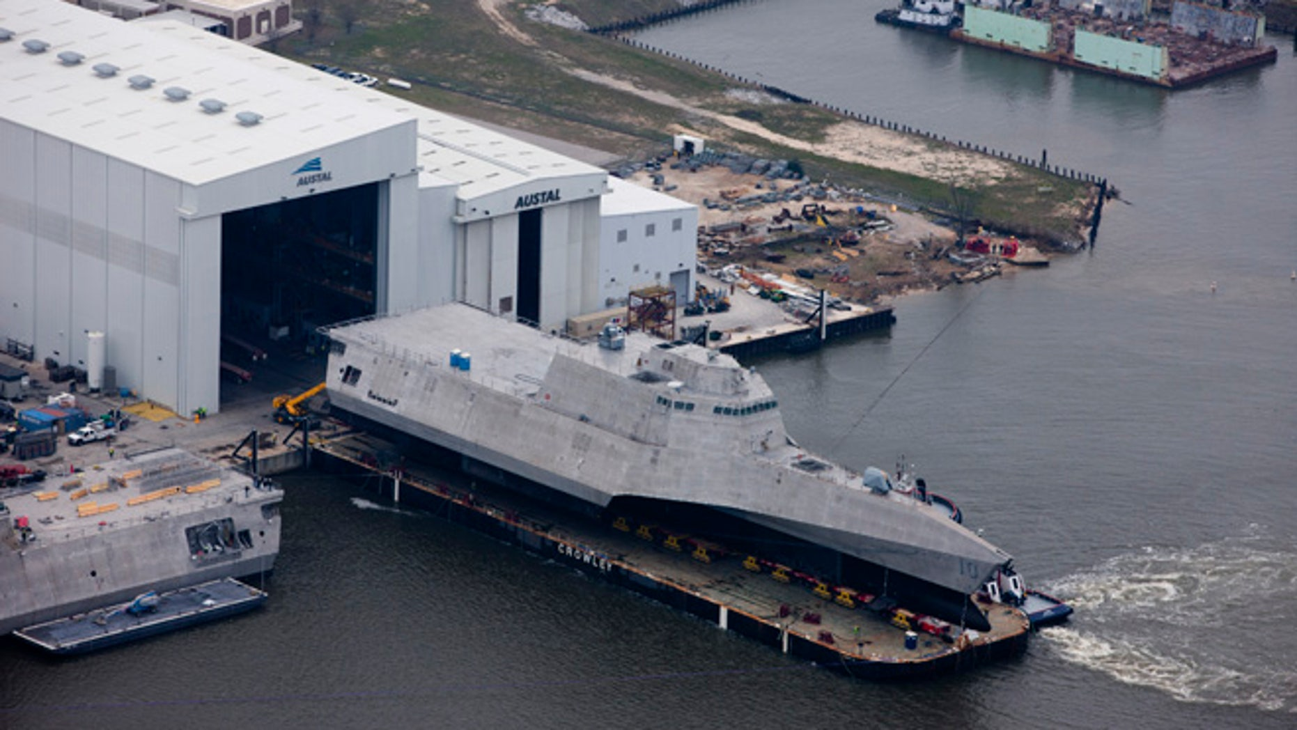 An aerial view of the future littoral combat ship USS Gabrielle Giffords (LCS 10) during its launch sequence at the Austal USA shipyard.