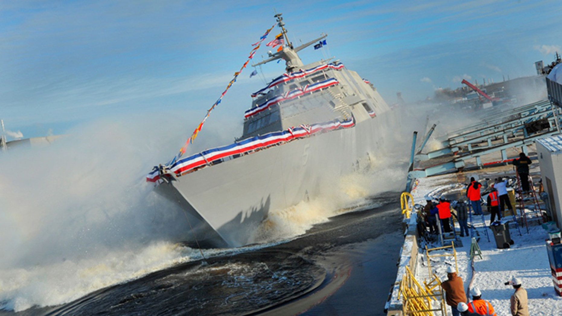 The littoral combat ship Pre-Commissioning Unit Milwaukee (LCS 5) slides into Lake Michigan during a christening ceremony at the Marinette Marine Corporation shipyard. (U.S. Navy photo courtesy of Lockheed Martin/Released)
