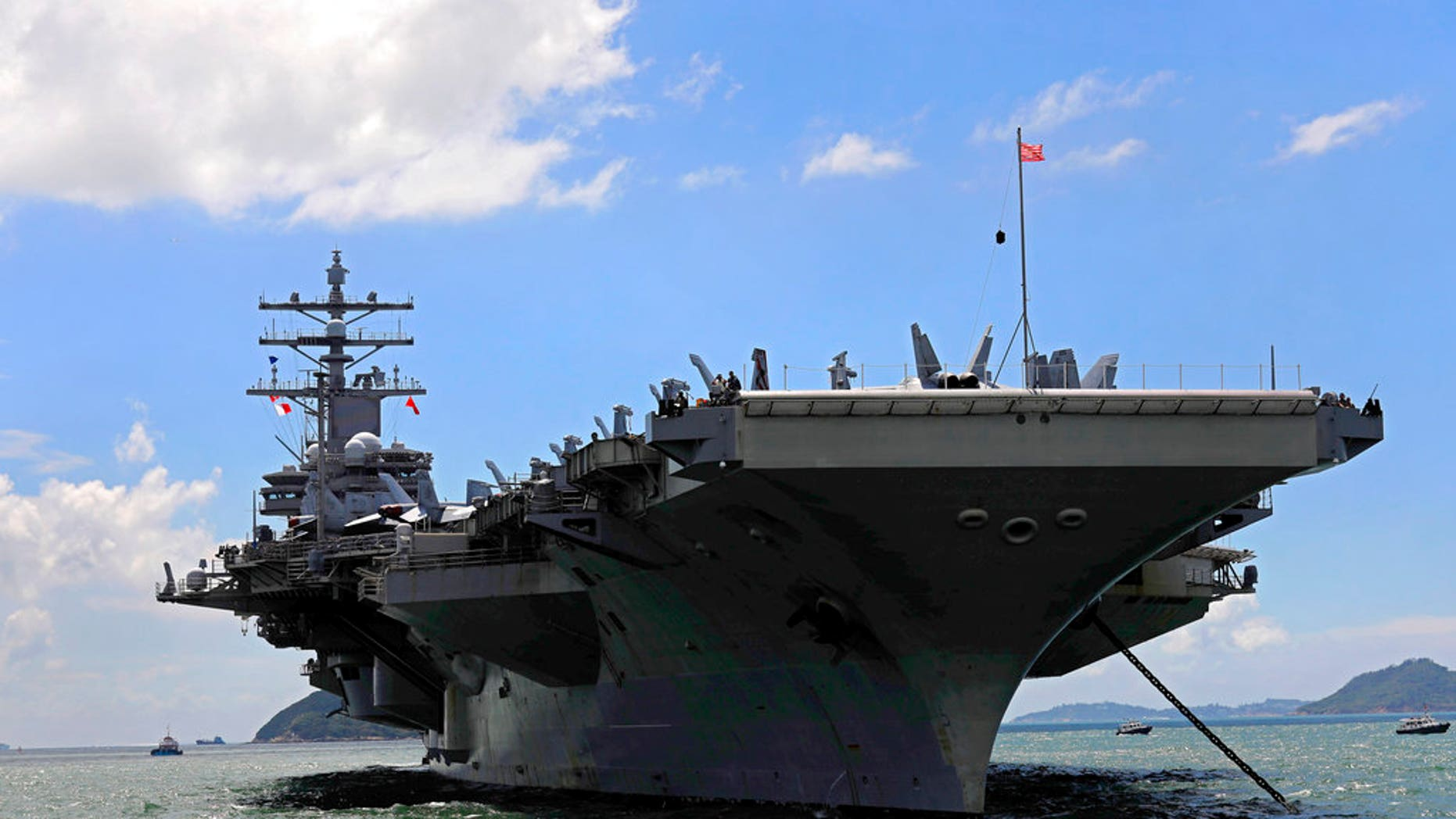 FILE - In this Monday, Oct. 2, 2017, file photo, the USS Ronald Reagan aircraft carrier arrives in Hong Kong. A U.S. Navy C-2 Greyhound plane carrying 11 crew and passengers crashed into the Pacific Ocean on Wednesday, Nov. 22, 2017, while on the way to the USS Ronald Reagan the Navy said. (AP Photo/Vincent Yu, File)