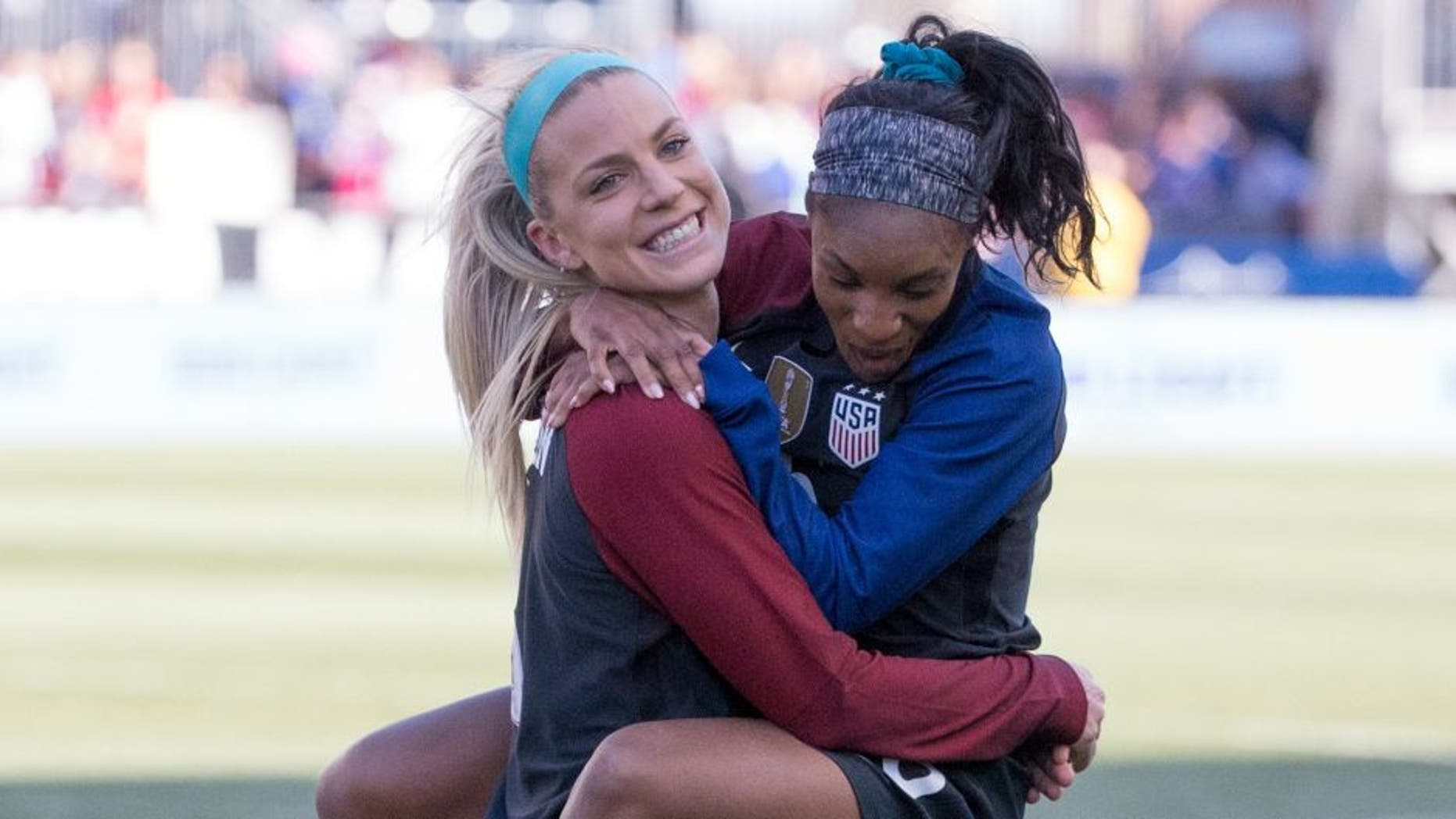 CHESTER, PENNSYLVANIA - APRIL 10: Julie Johnston #8 and Crystal Dunn #16 of the United States hug each other after the match against Colombia at Talen Energy Stadium on April 10, 2016 in Chester, Pennsylvania. The United States defeated Colombia 3-0. (Photo by Mitchell Leff/Getty Images) *** Local Caption *** Julie Johnston;Crystal Dunn