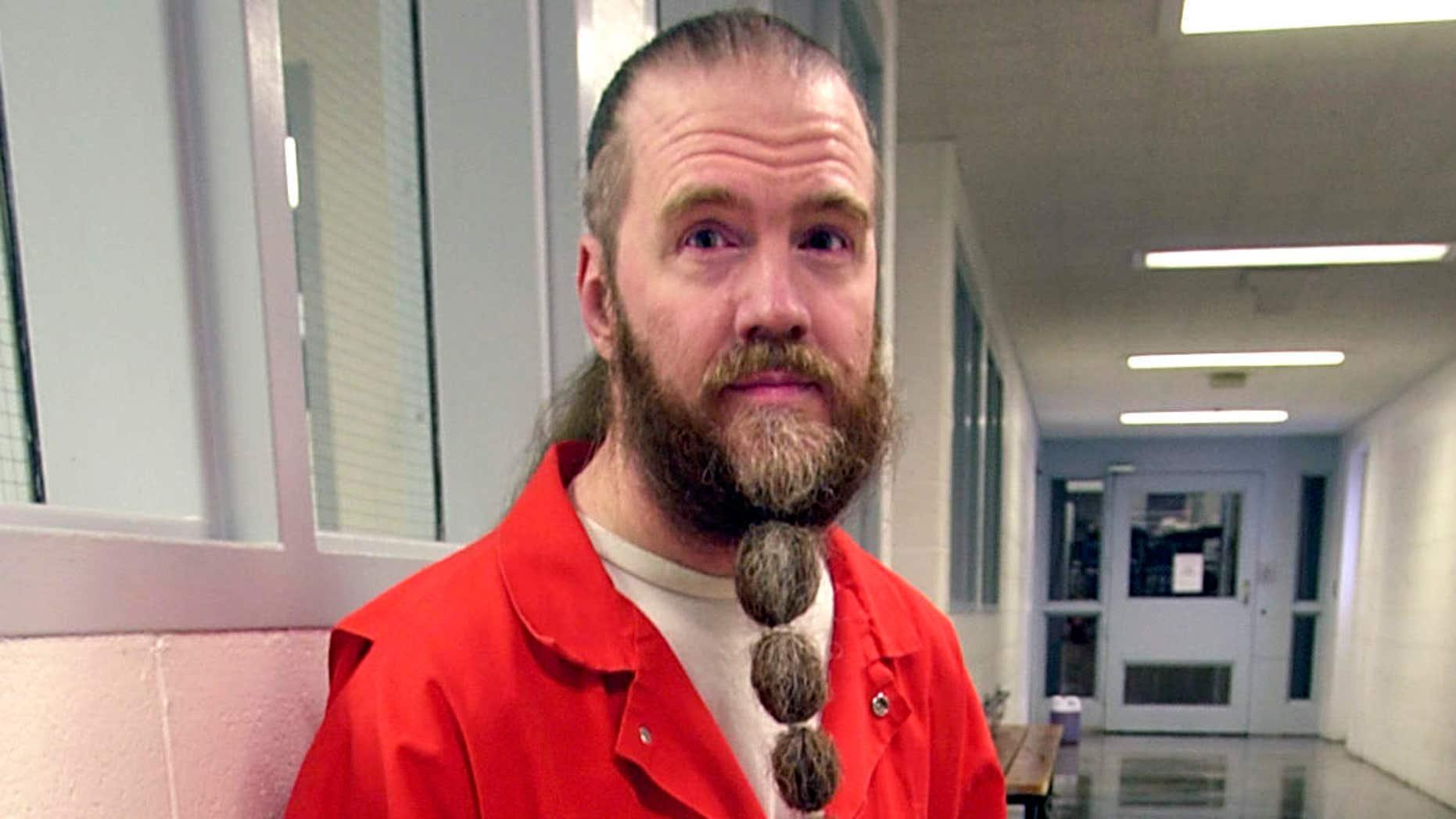 June 30, 2003: Dan Lafferty poses for a photograph, at Utah State Prison in Draper, Utah.