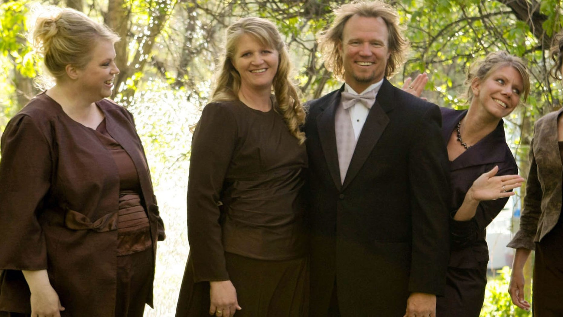 """Kody Brown, center, poses with his wives, from left, Janelle, Christine, Meri, and Robyn in a promotional photo for TLC's reality TV show, """"Sister Wives."""""""