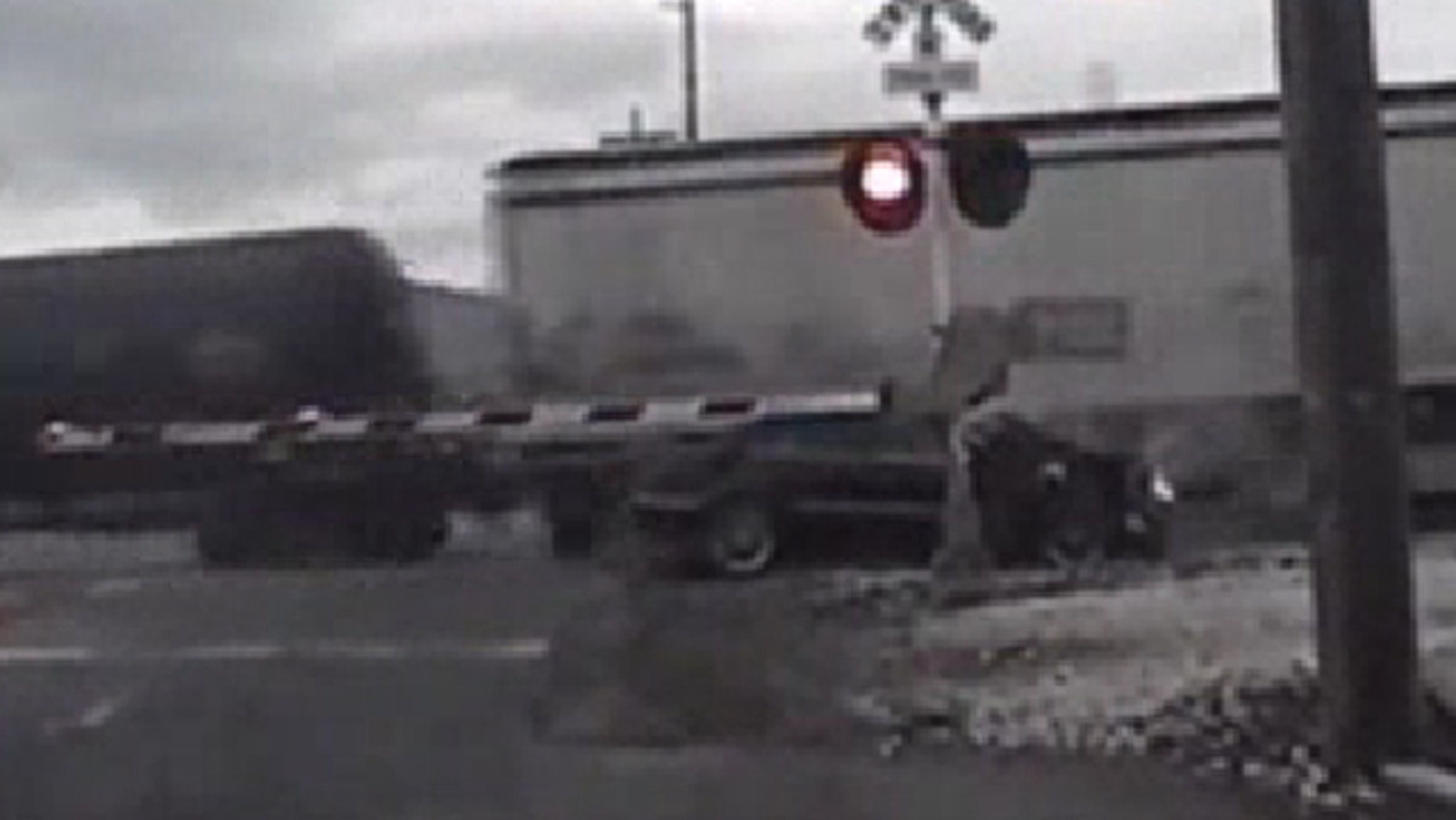 Oct. 15, 2013: Authorities say a woman who was trying to evade police was injured when the car she was driving crashed into a train and then was struck by a second train.