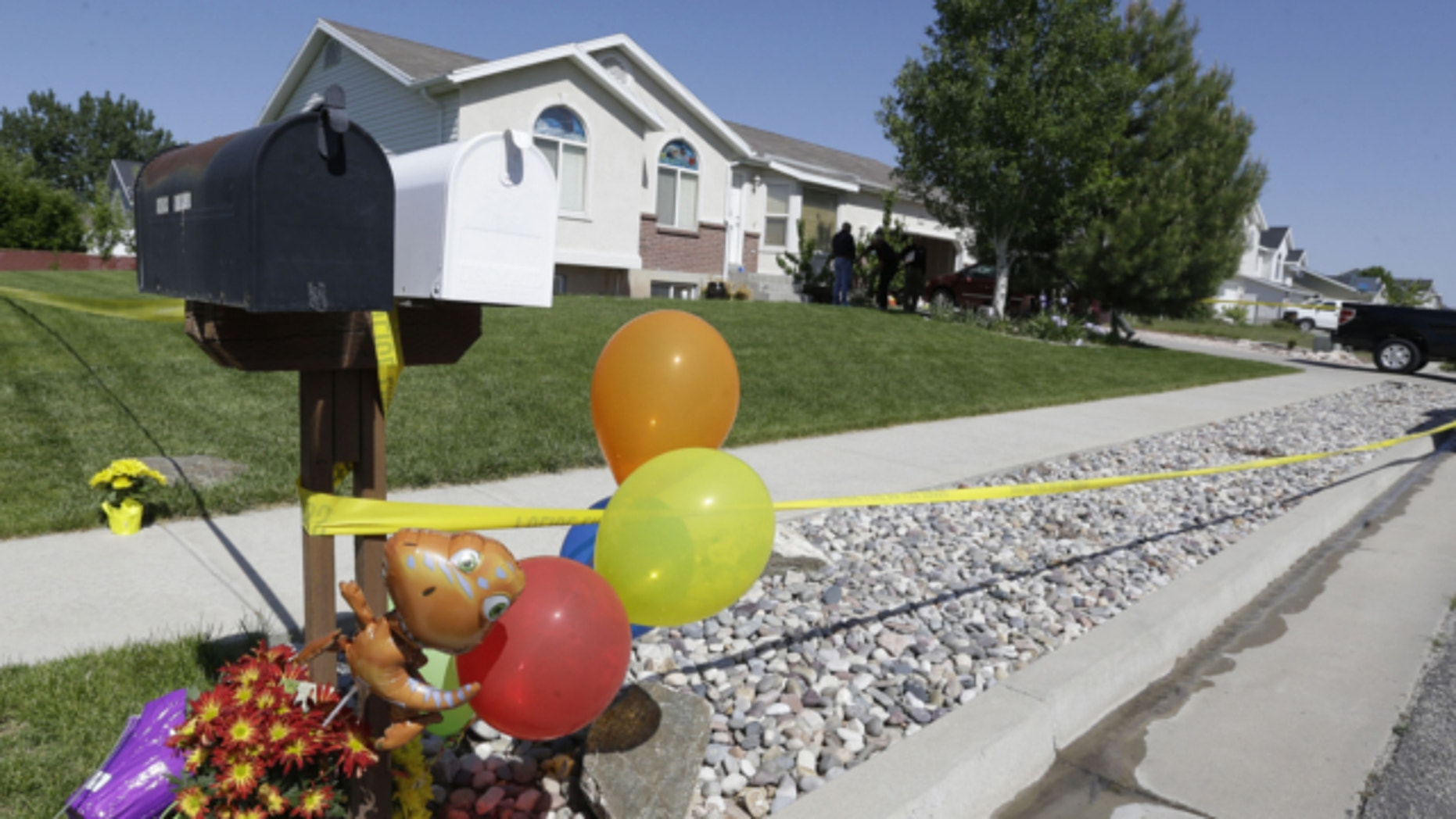 May 23, 2013: The home where two brothers were found dead is shown in West Point, Utah.