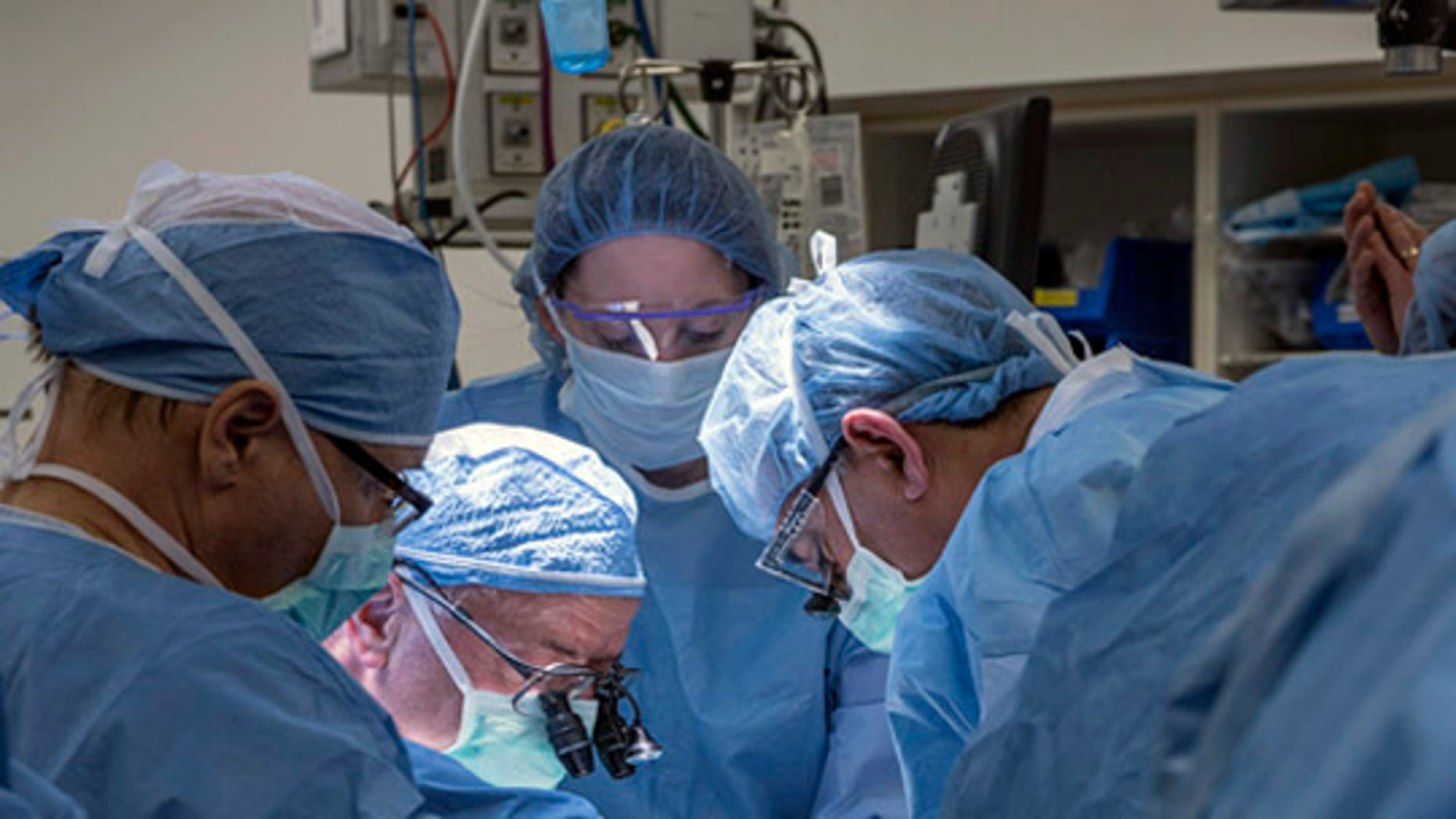 Ffeb. 24, 2016: In this photo provided by Cleveland Clinic Center, a team of Cleveland Clinic transplant surgeons and gynecological surgeons perform the nation''s first uterus transplant during a nine-hour surgery in Cleveland. (Cleveland Clinic Center via AP)